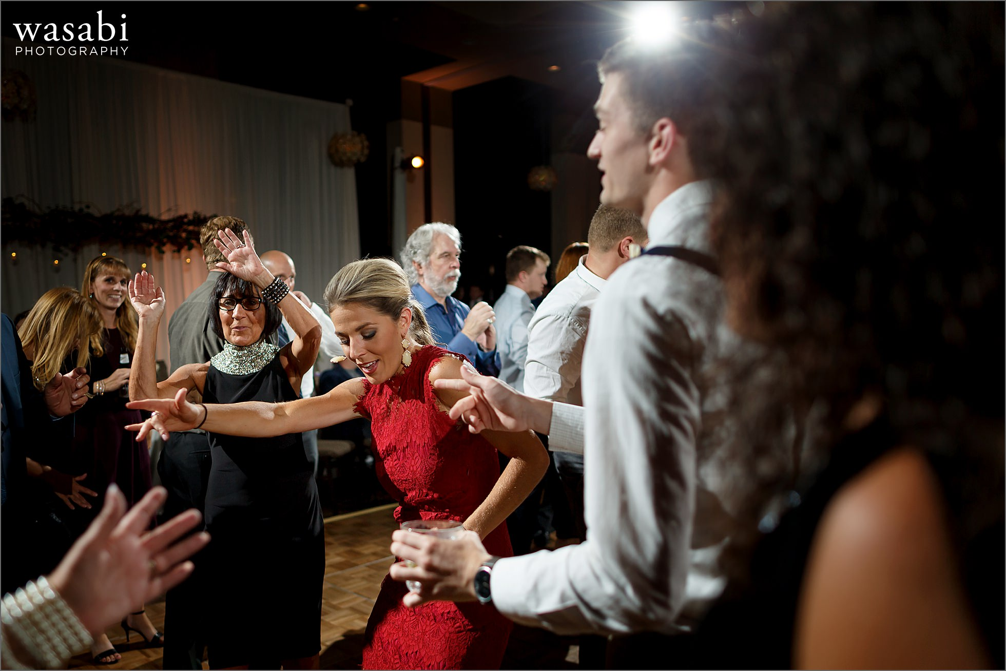 guests dance during Lombard Westin Hotel wedding photos at reception in ballroom