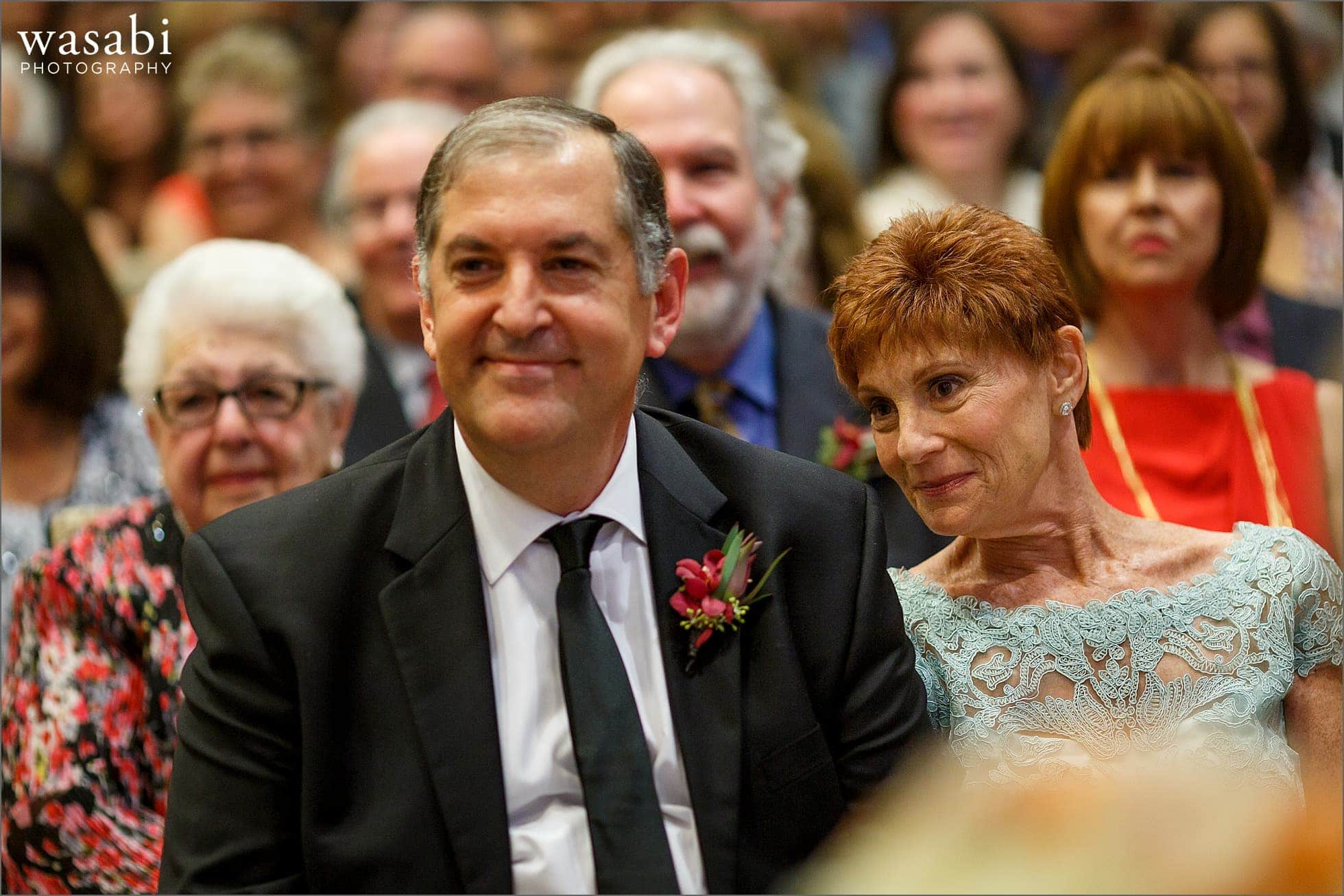 parents react while watching wedding ceremony at Lombard Westin Hotel