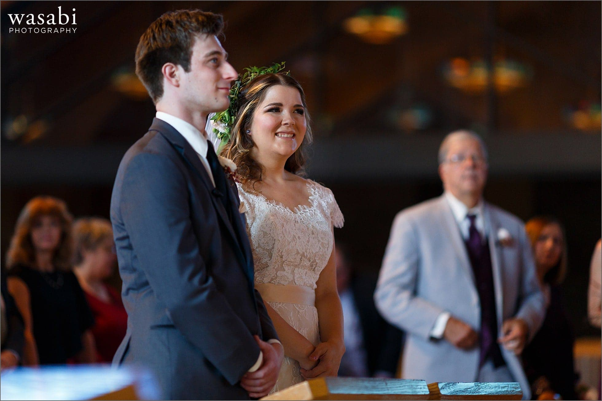 bride and groom smile during their wedding ceremony at Sacred Heart Catholic Church in Palos Hills