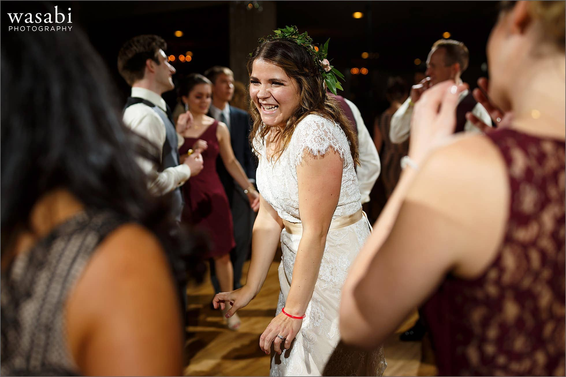 bride dances with guests during Palos Country Club wedding reception in Orland Park