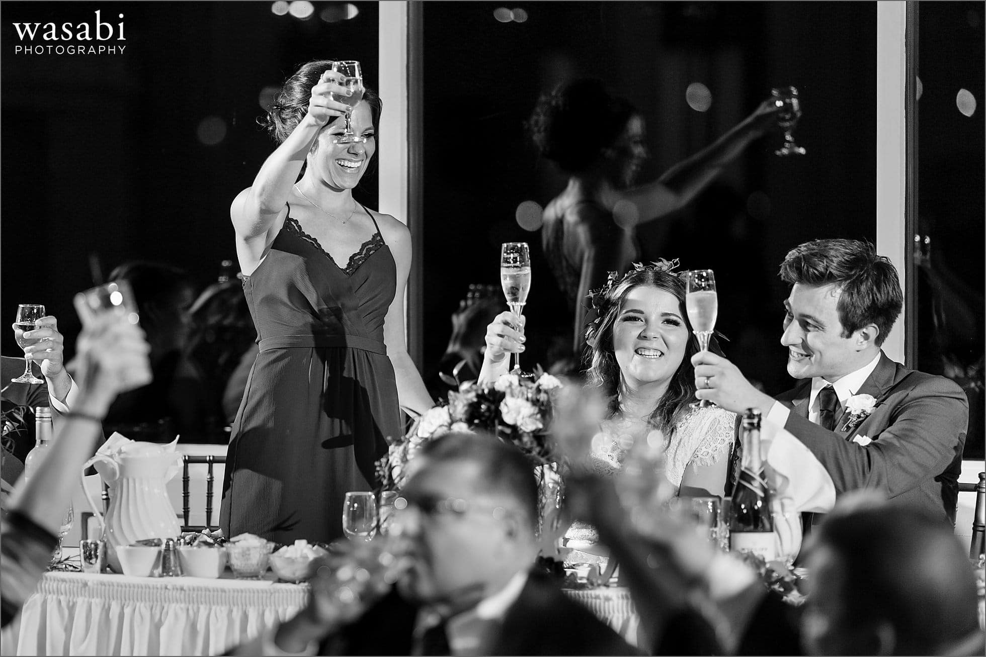bridesmaid toasts the couple during Palos Country Club wedding reception in Orland Park