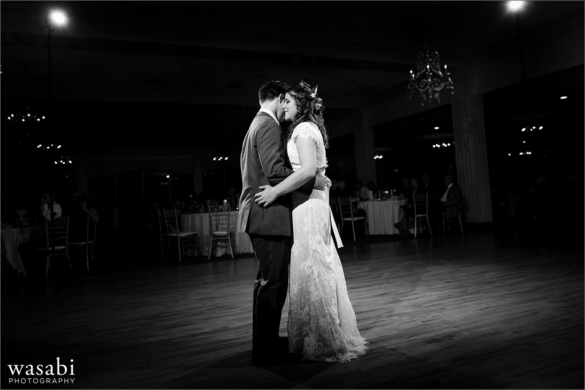 couple shares a first dance during Palos Country Club wedding reception in Orland Park