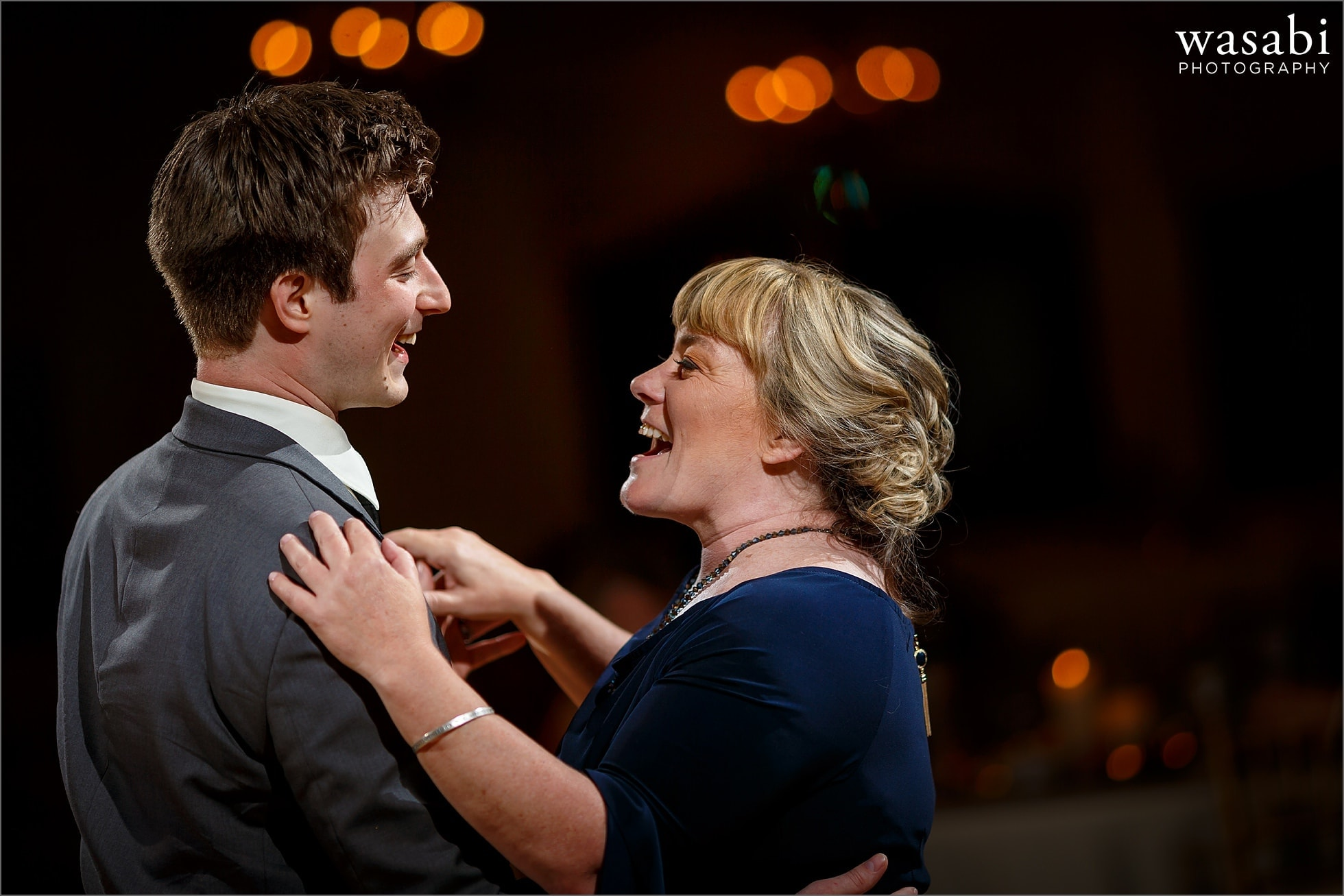 groom dances with mother during Palos Country Club wedding reception in Orland Park