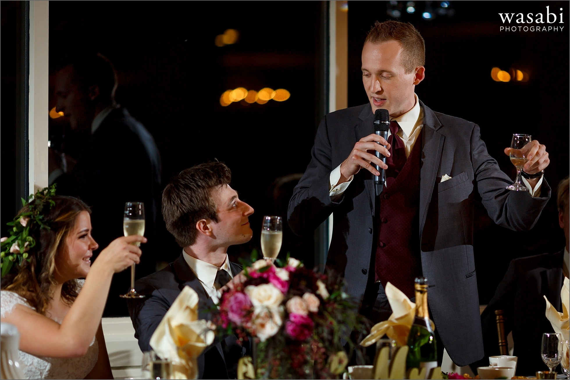 groomsmen toasts the couple during Palos Country Club wedding reception in Orland Park
