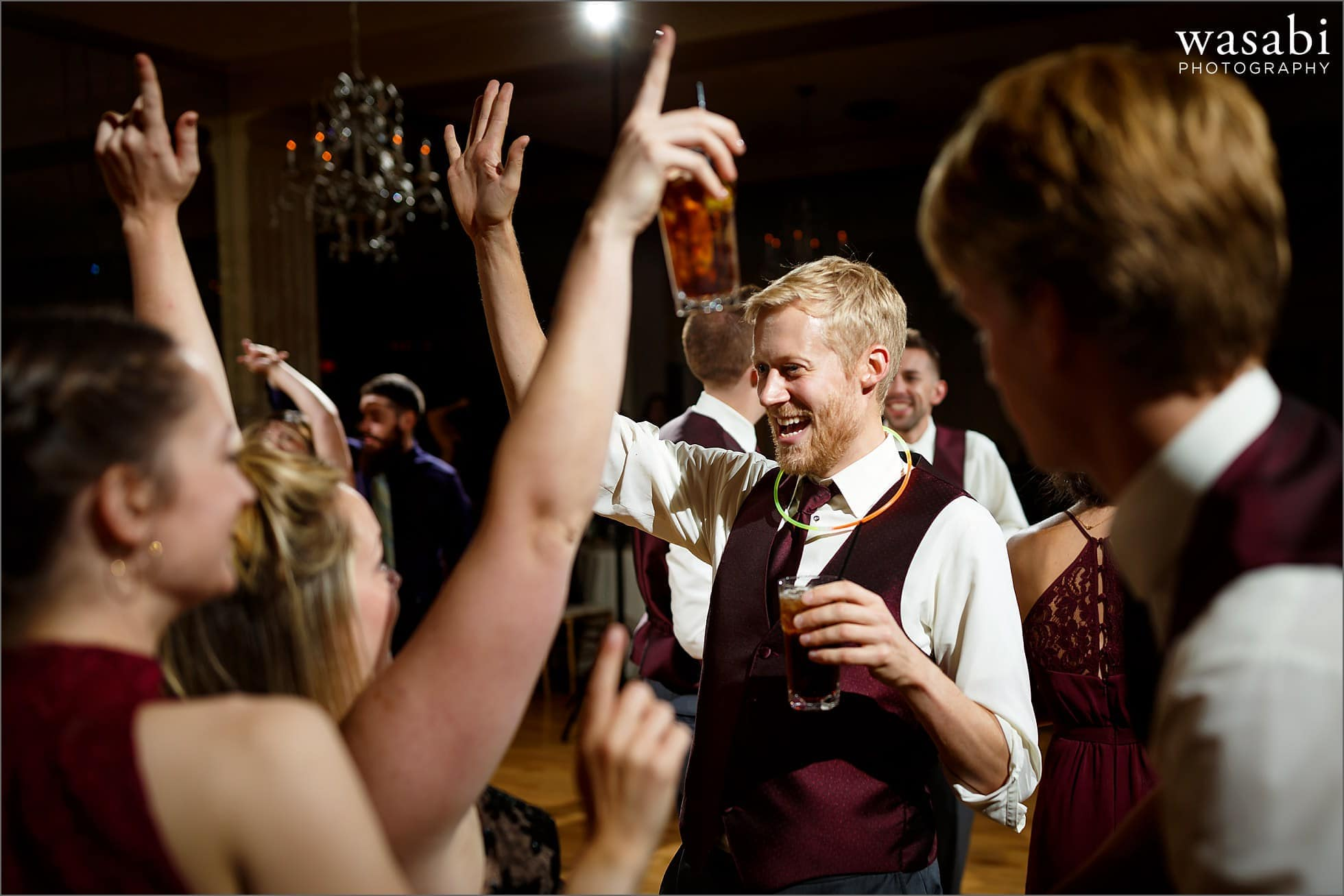 wedding party dances during Palos Country Club wedding reception in Orland Park