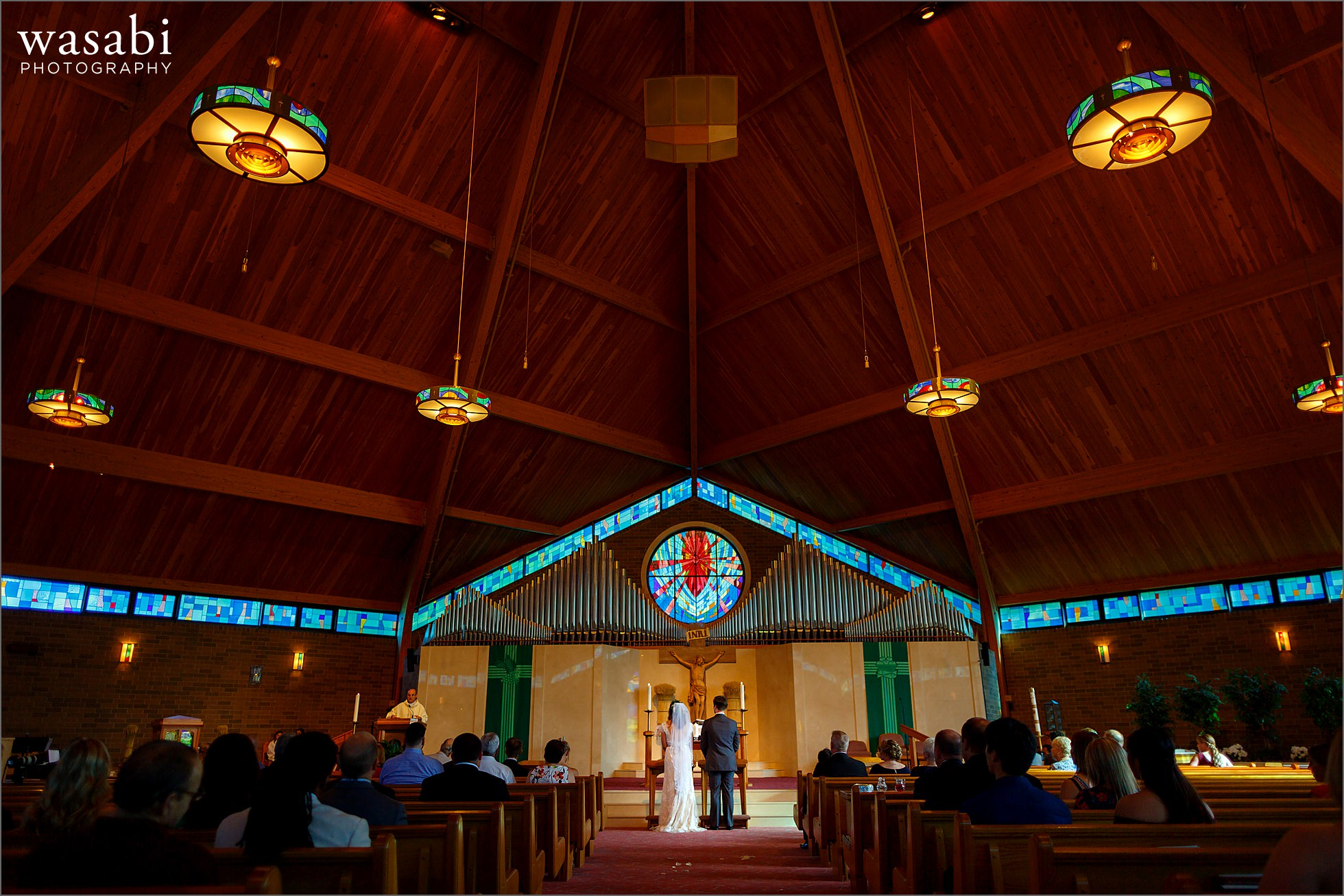 wide angle view showing the full interior during wedding ceremony at Sacred Heart Catholic Church in Palos Hills