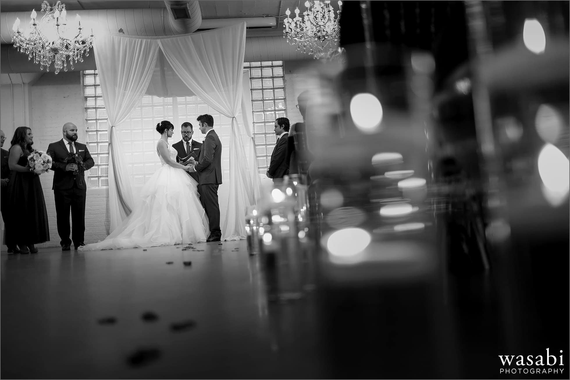 bride and groom exchange rings during wedding ceremony at Room 1520 in Chicago