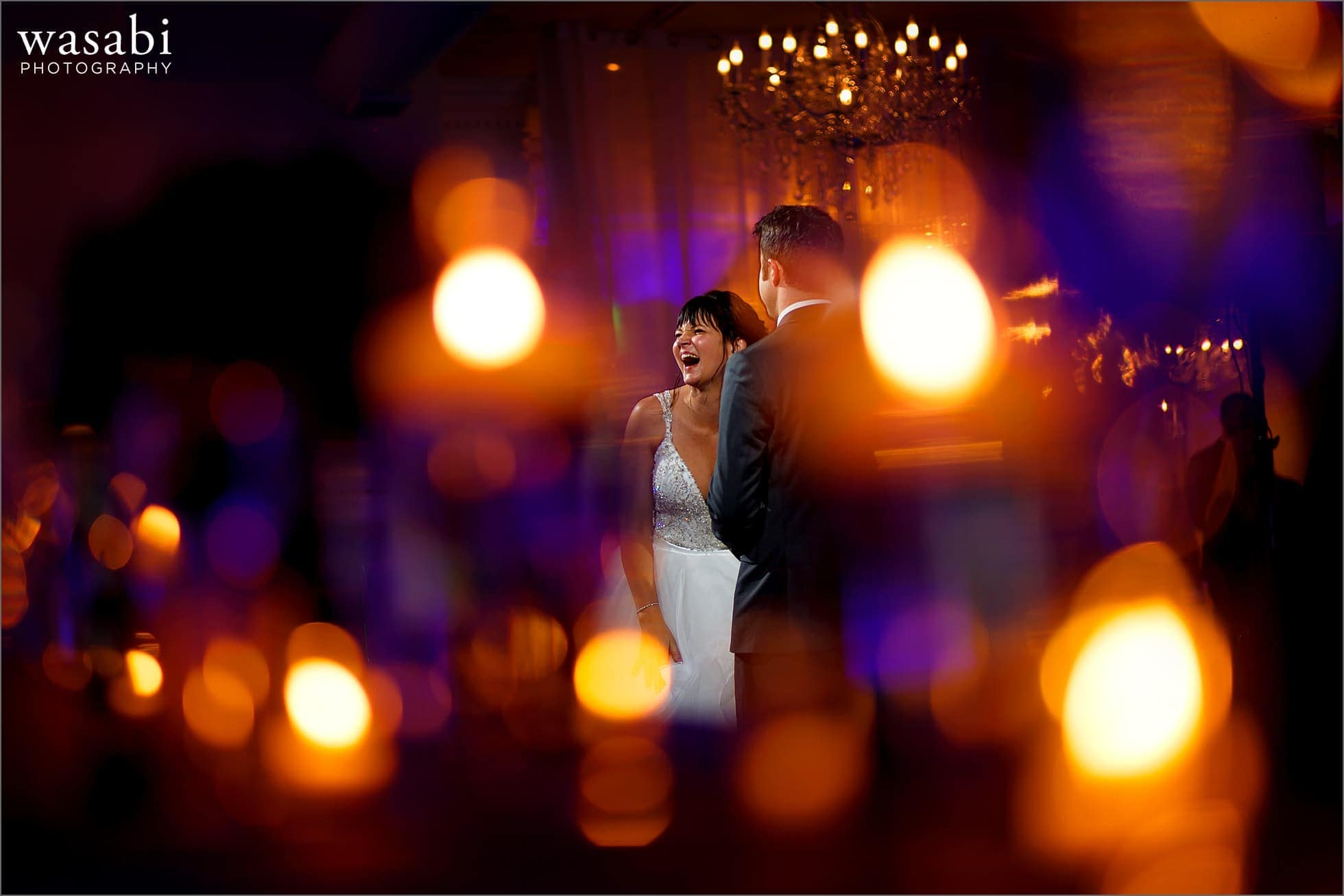 bride and groom laugh while dancing at Room 1520 wedding photos