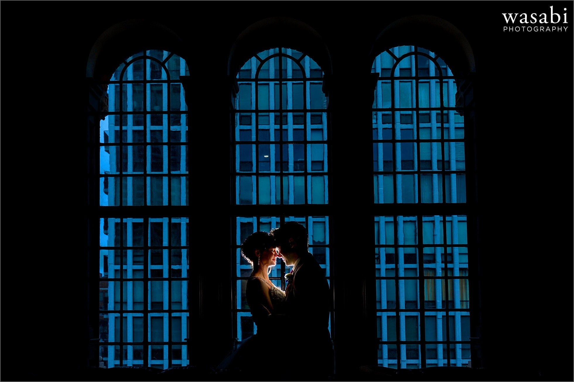bride and groom pose for wedding portrait at Drumbar in Rafaello Hotel in Chicago