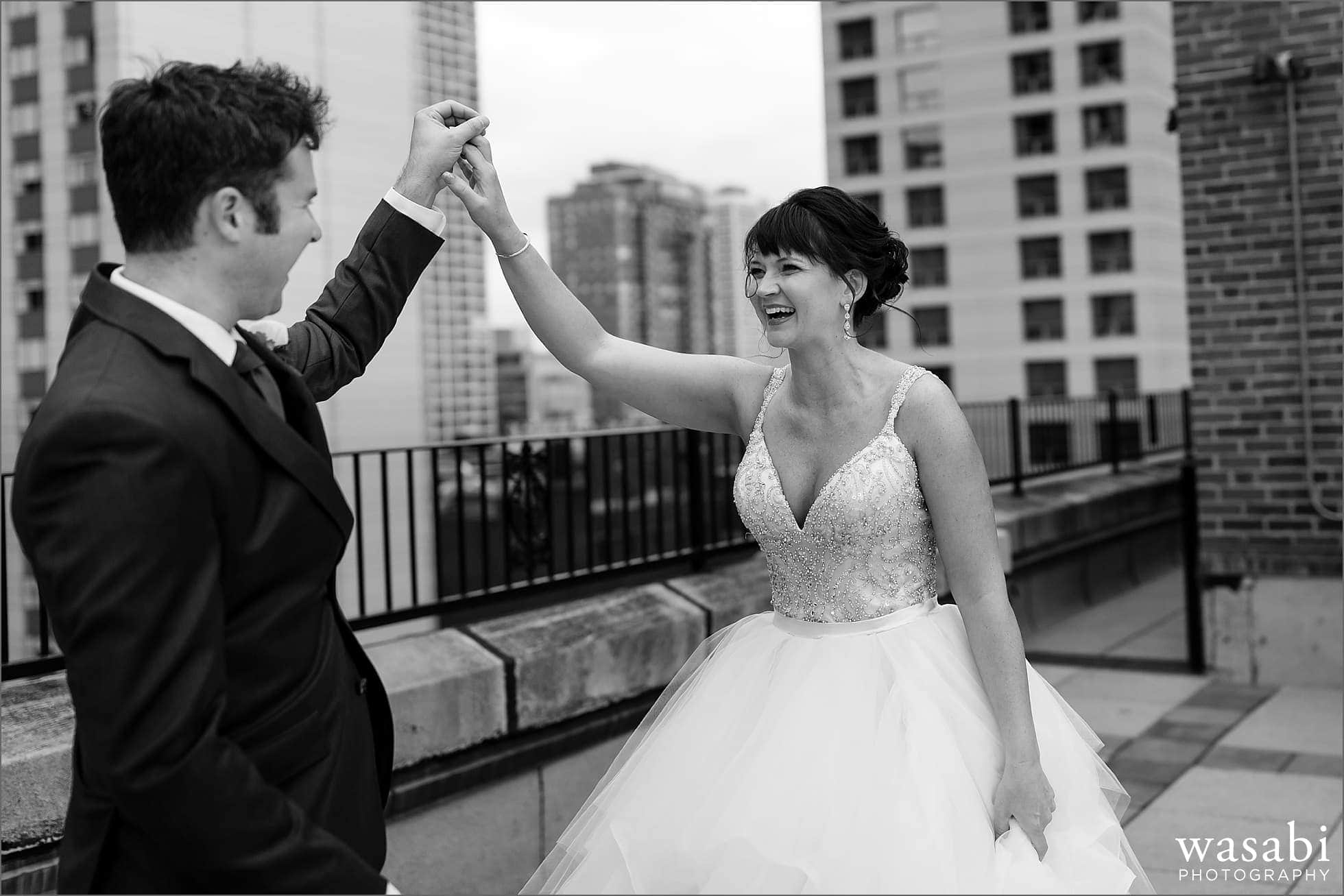 bride and groom react after seeing each other for a first look on the roof of Raffaello Hotel in Chicago
