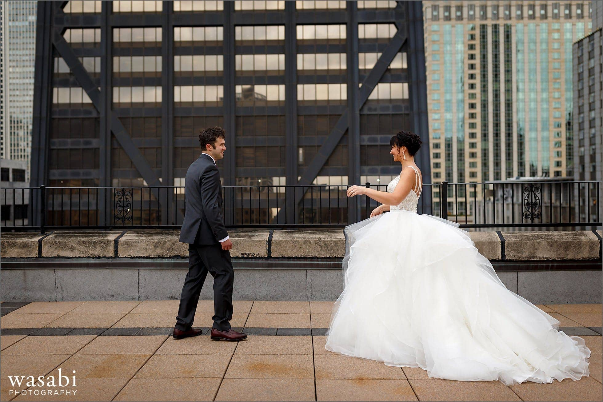 bride and groom see each other for a first look on the roof of Raffaello Hotel in Chicago