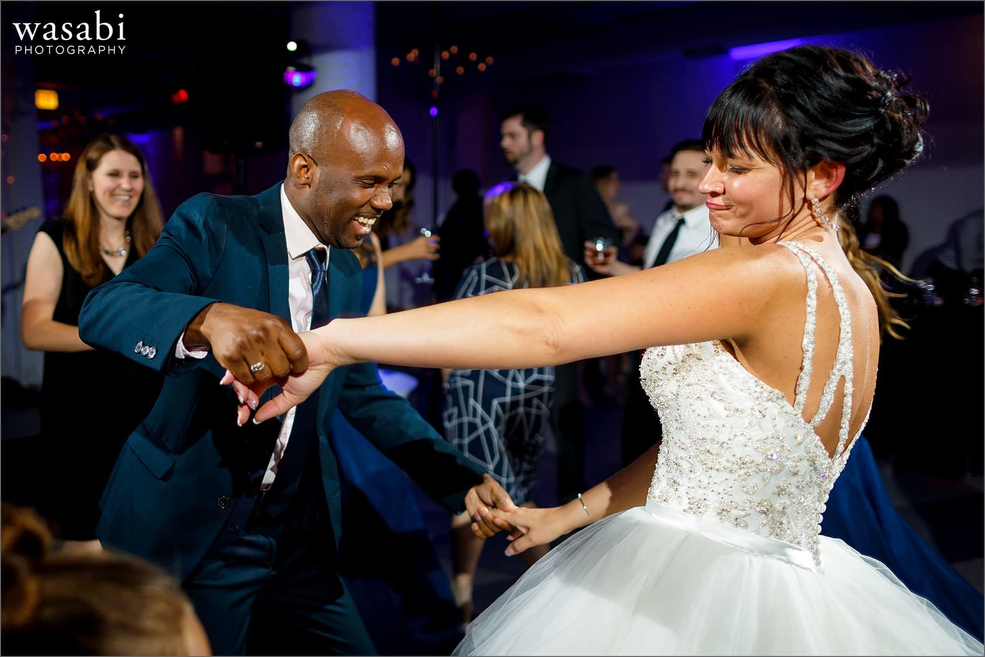 bride dances with friend during wedding reception at Room 1520 in Chicago