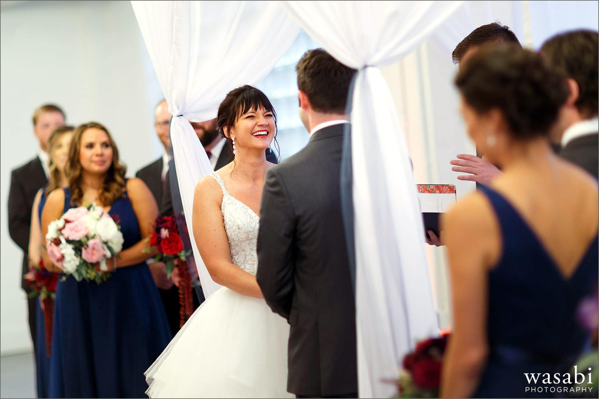 bride laughs during wedding ceremony at Room 1520 in Chicago