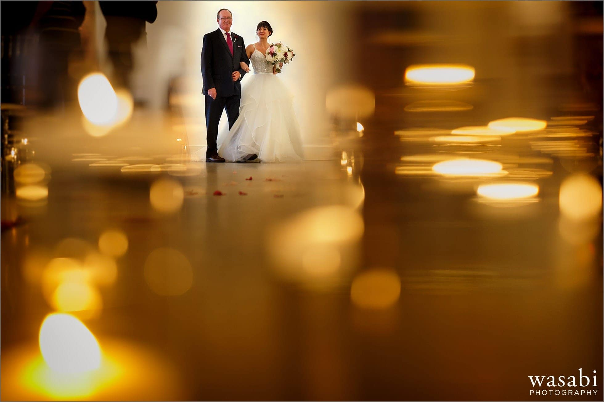 bride walks down the aisle with her father during wedding ceremony at Room 1520 in Chicago