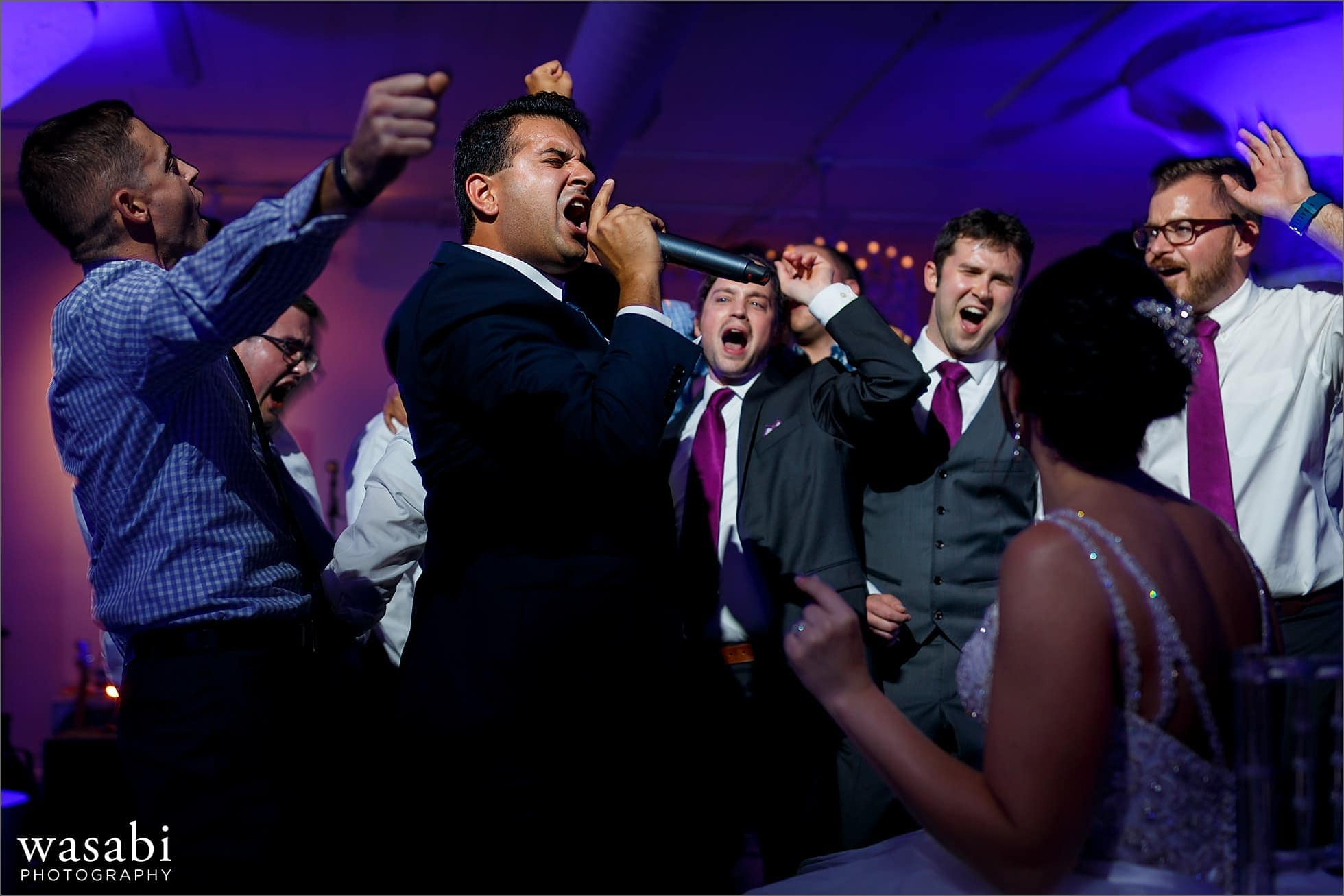 groom and friends sing to during wedding reception at Room 1520 in Chicago