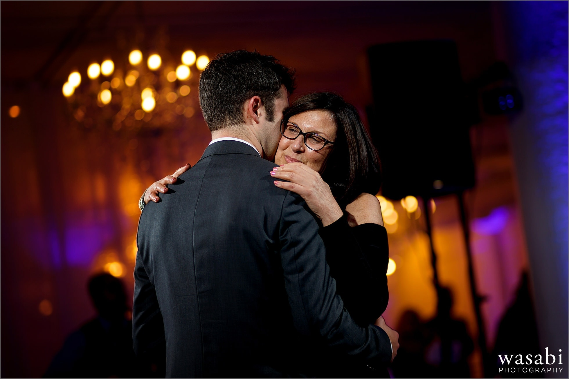 groom dances with mother during wedding reception at room 1520 in Chicago