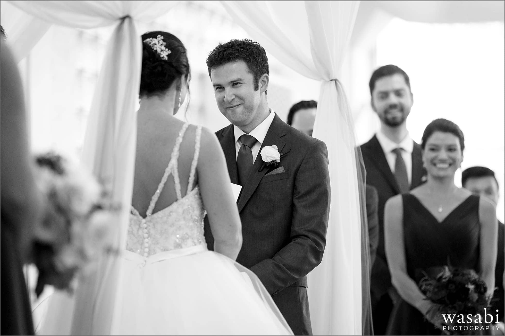 groom laughs during wedding photos at Room 1520 in Chicago