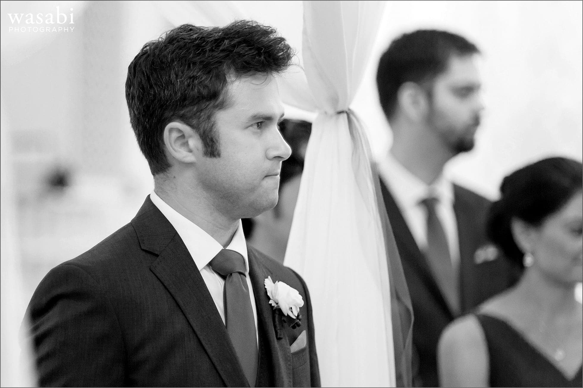 groom reacts to bride walking down the aisle during wedding ceremony at Room 1520 in Chicago