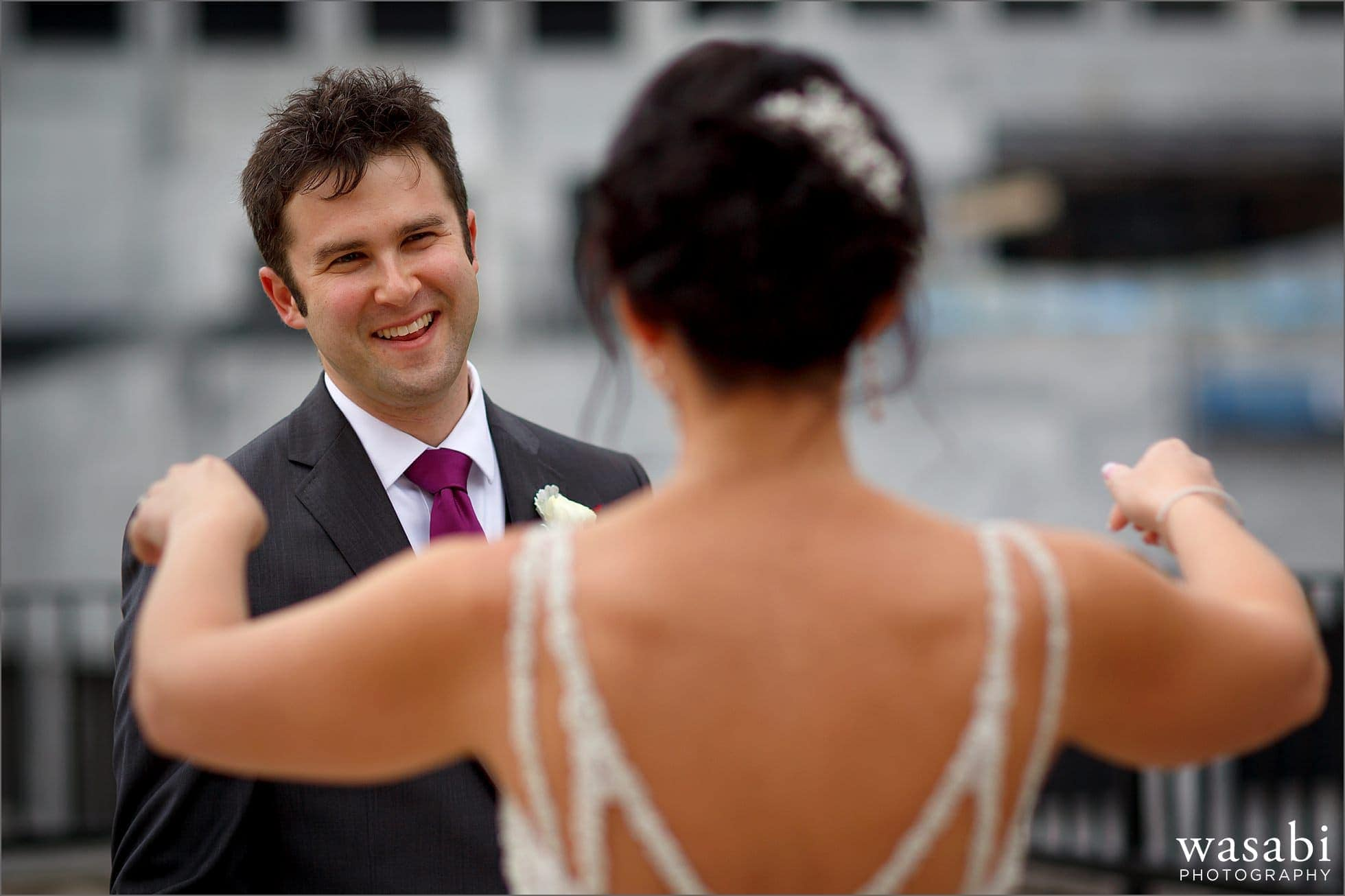 groom reacts to seeing his bride for a first look on the roof of Raffaello Hotel in Chicago