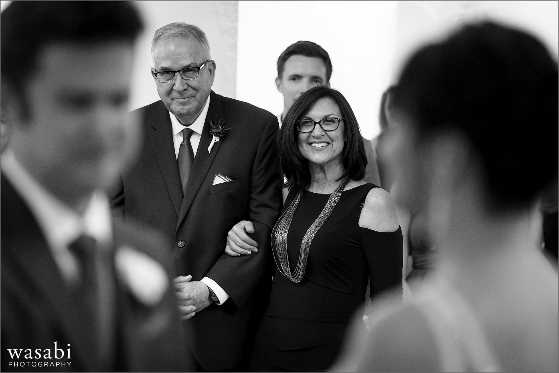 grooms parents smile as the watch wedding ceremony at Room 1520 in Chicago