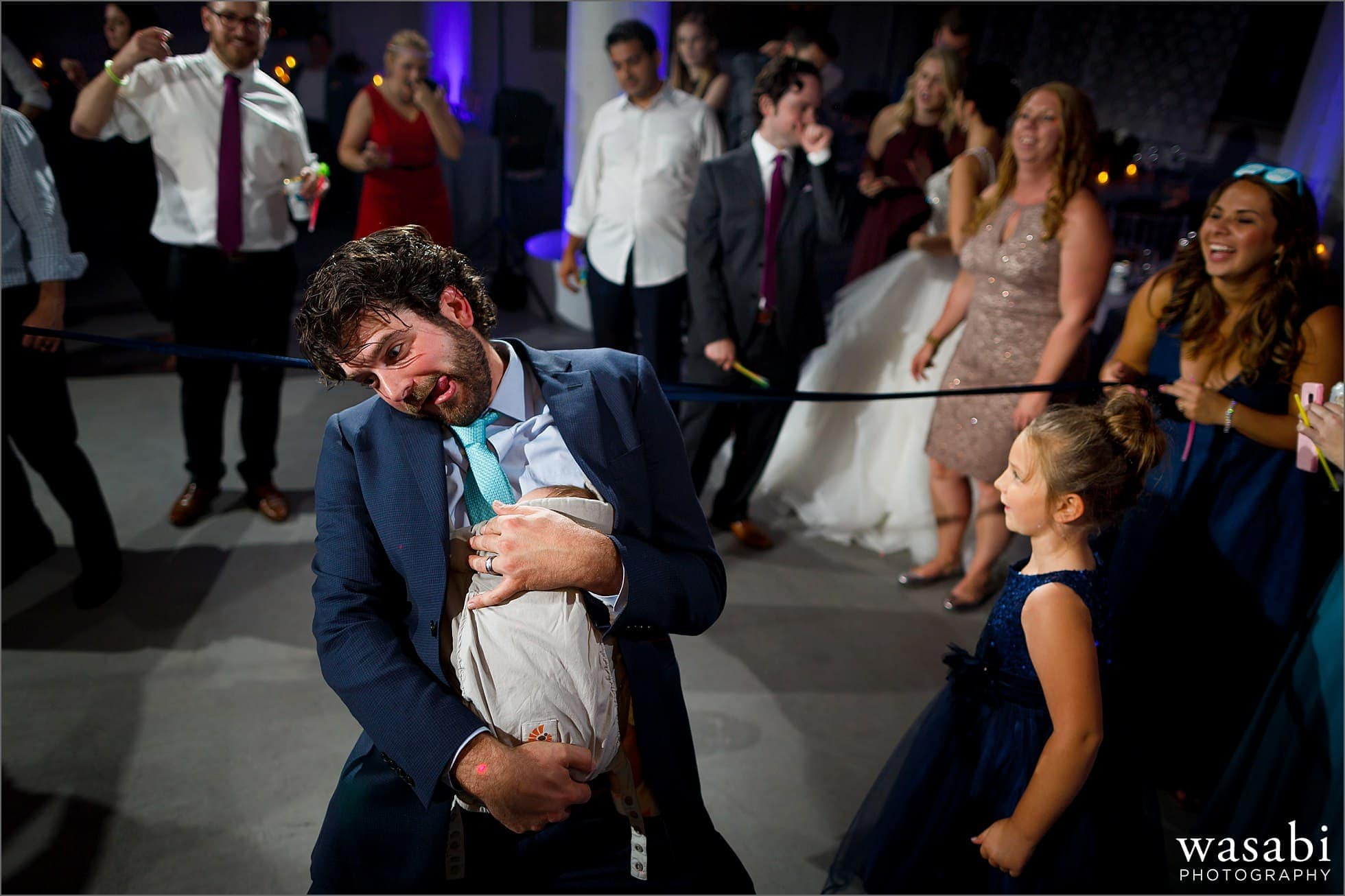 wedding guest limbo with baby during wedding reception at Room 1520 in Chicago