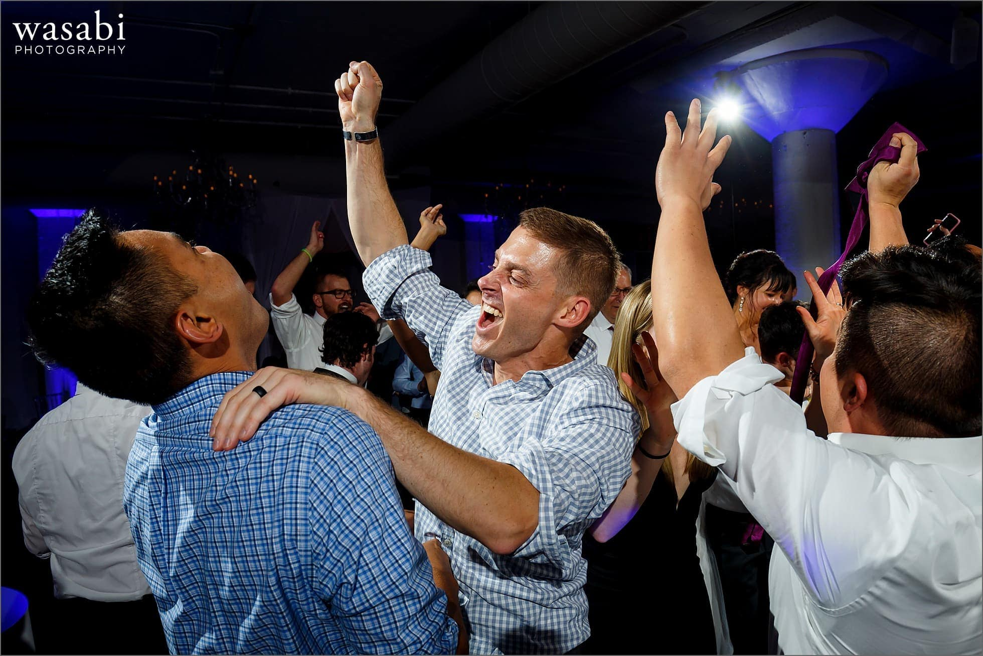 wedding guests dance during reception at Room 1520 in Chicago