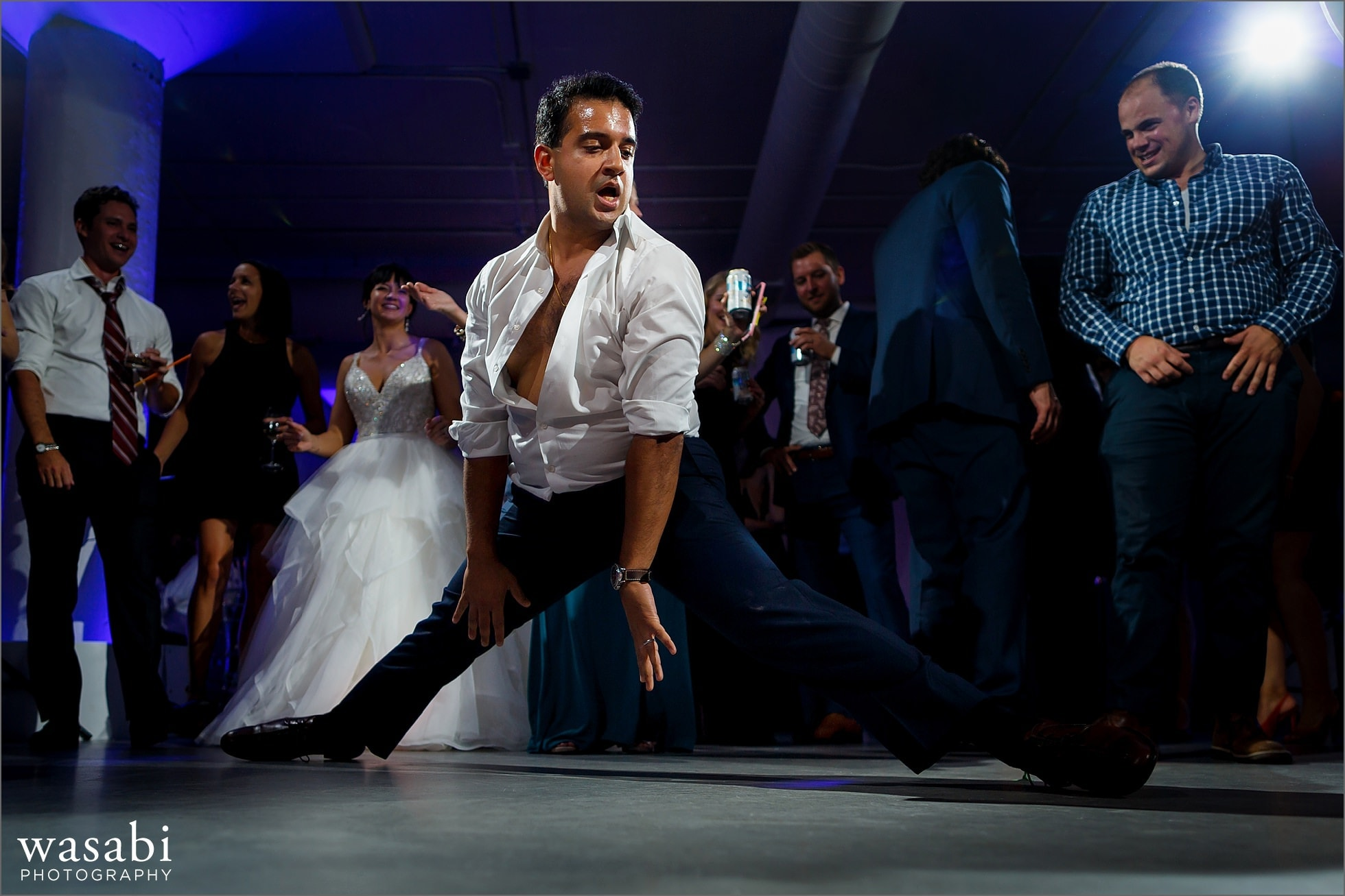 wedding guests does the splits on the dance floor during reception at Room 1520 in Chicago