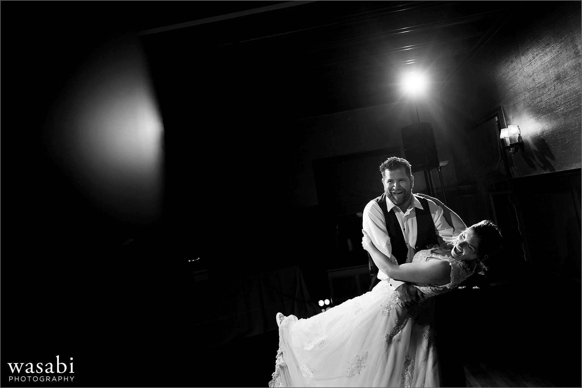 bride and groom dance together at Cheney Mansion wedding reception
