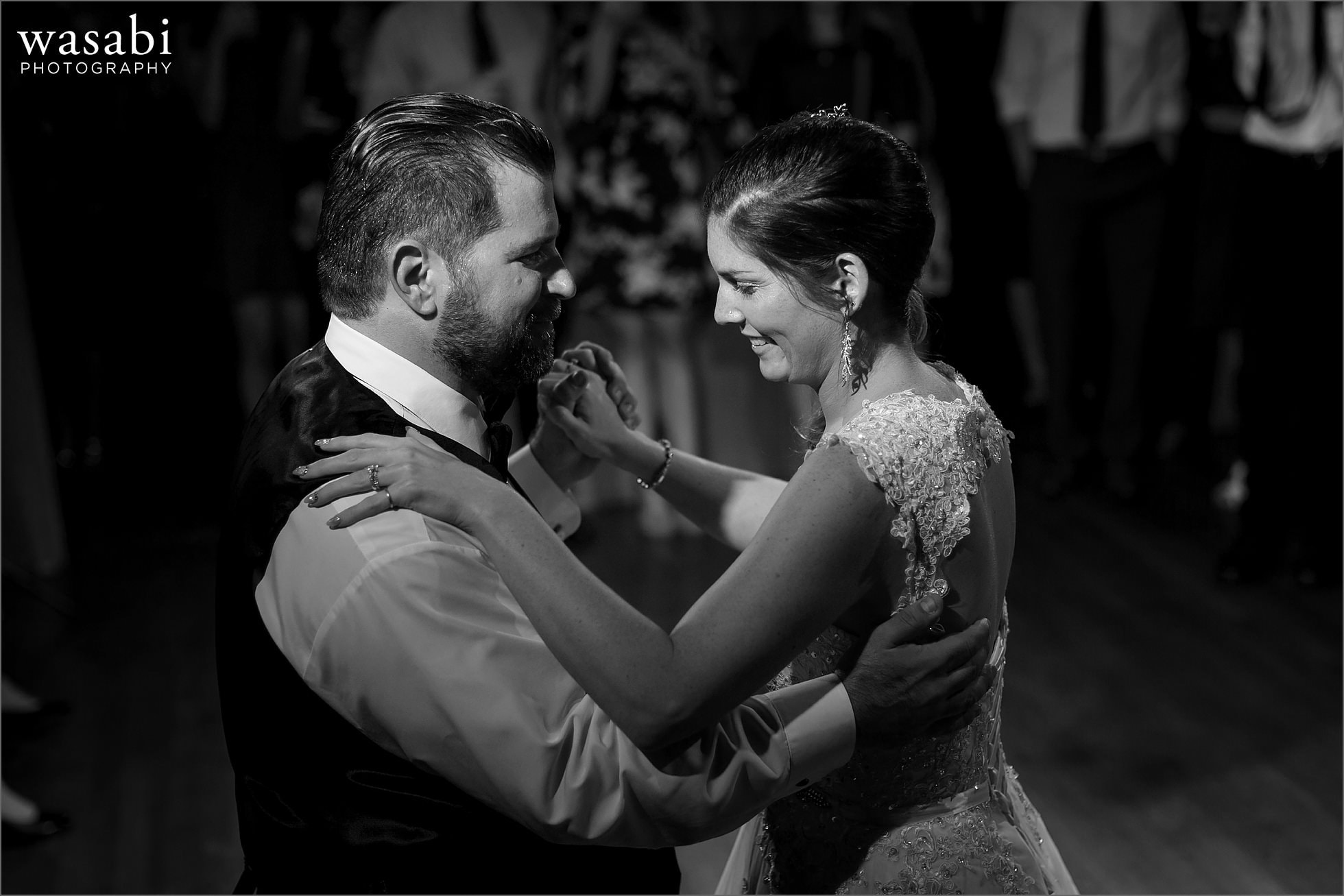 bride and groom first dance together during wedding reception at Cheney Mansion in Oak Park