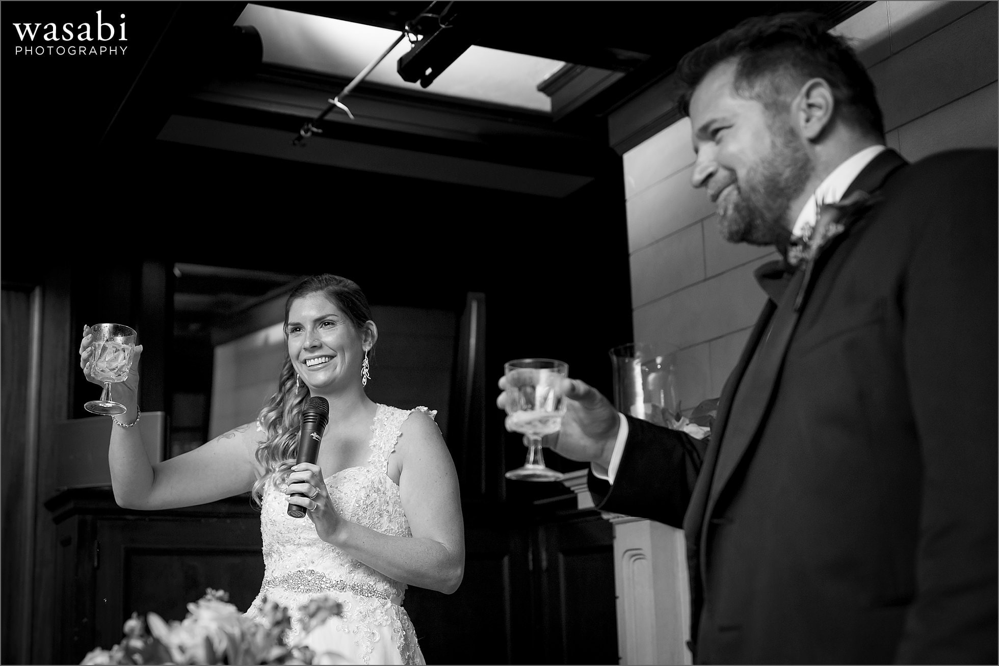 bride and groom give toast during wedding reception at Cheney Mansion in Oak Park
