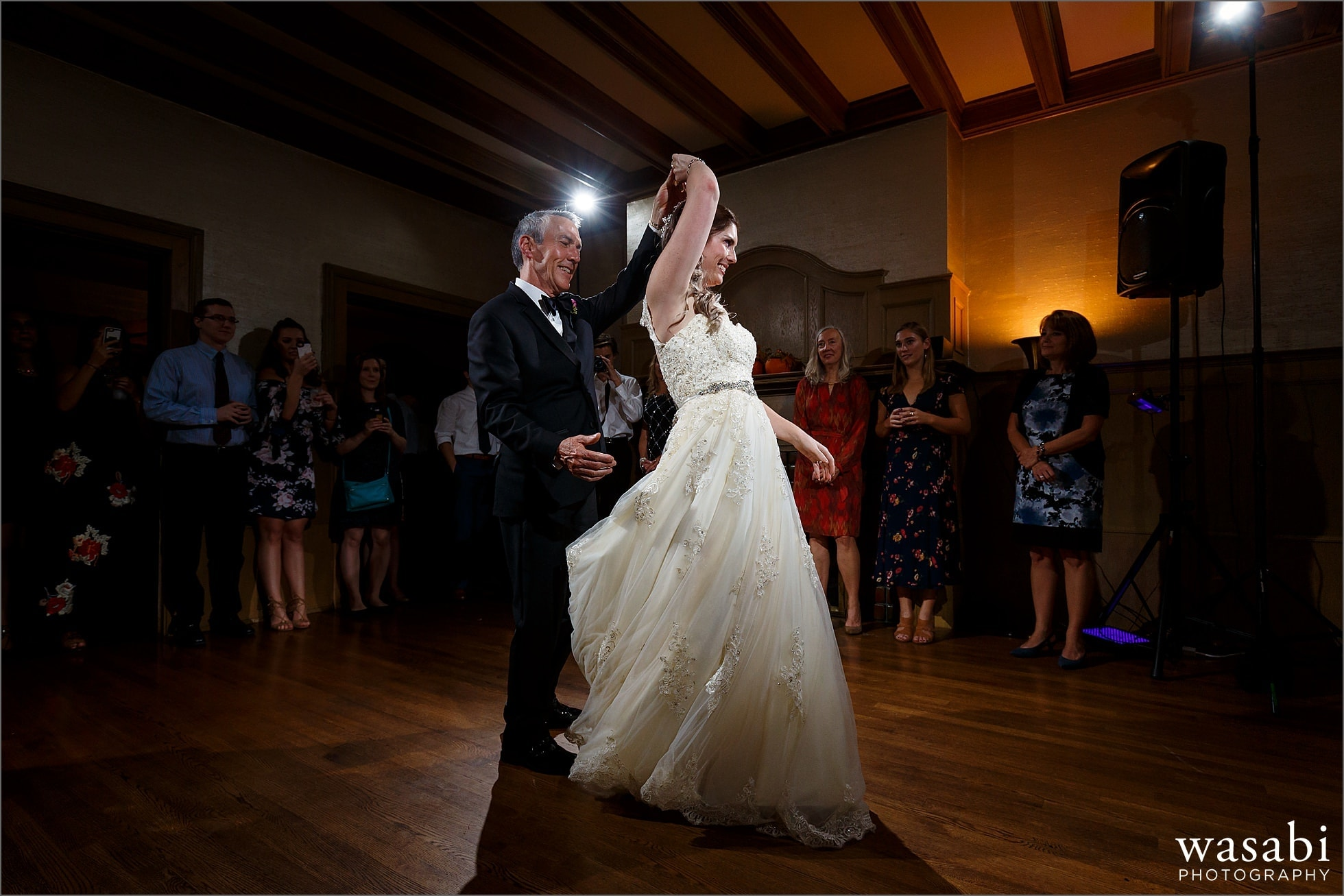 bride dances with father of the bride during first dances at Cheney Mansion wedding reception