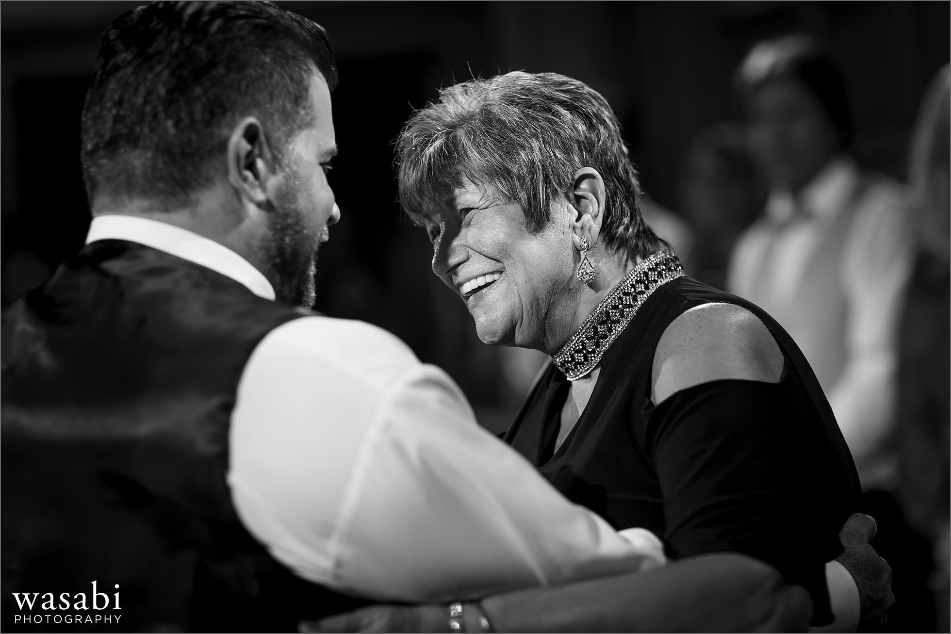 groom dances with mother during wedding reception at Cheney Mansion in Oak Park