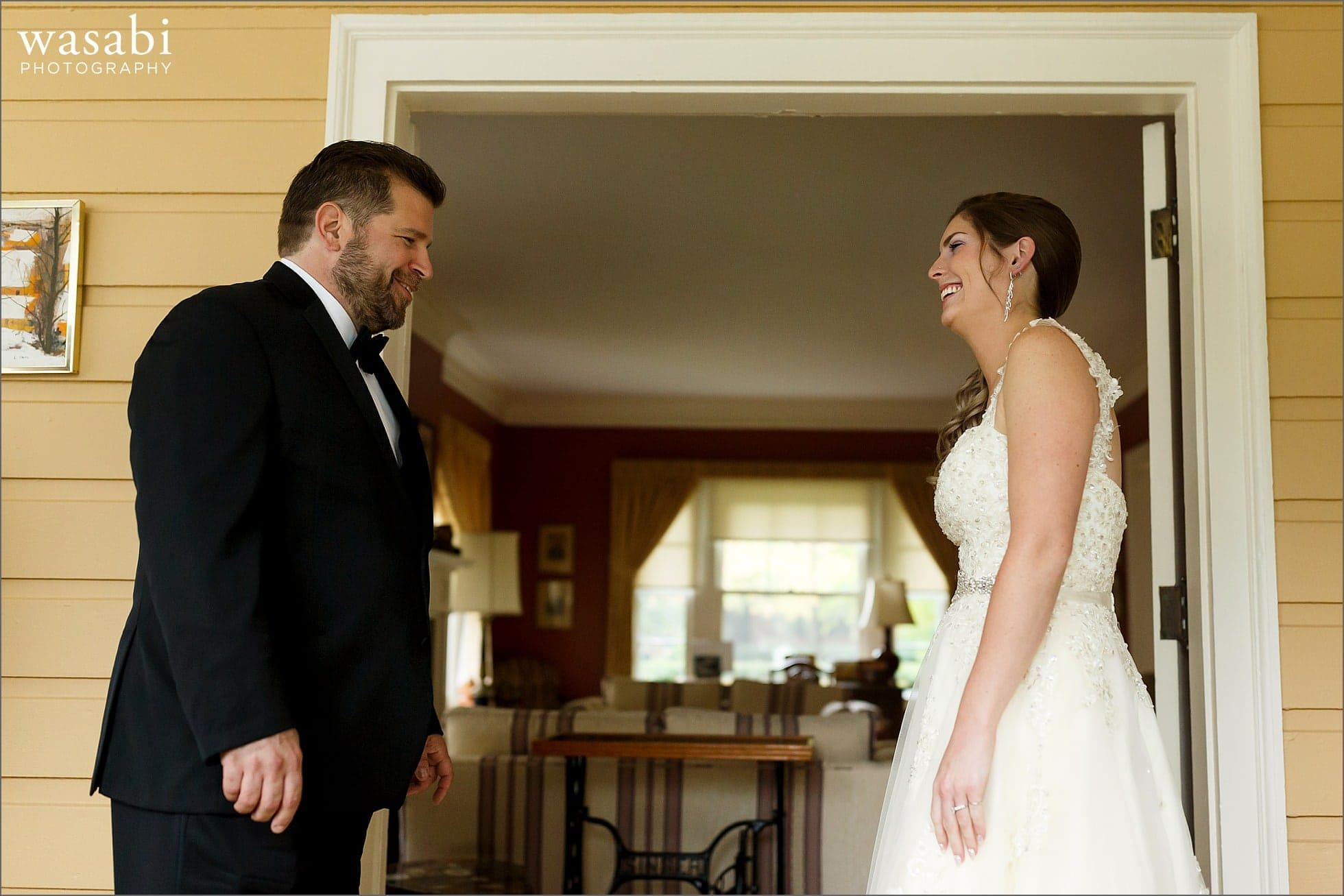 groom reacts during first look with bride in her home