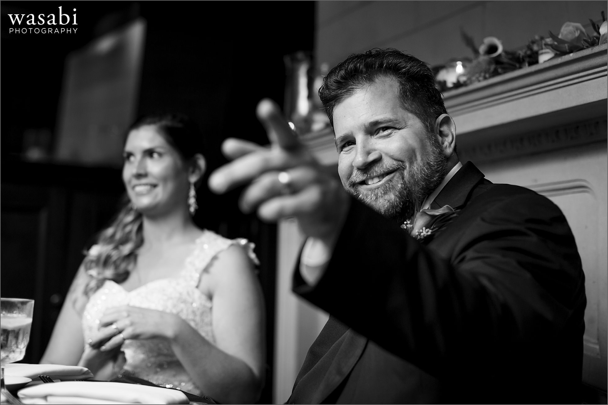 groom reacts during toasts at reception at Cheney Mansion in Oak Park