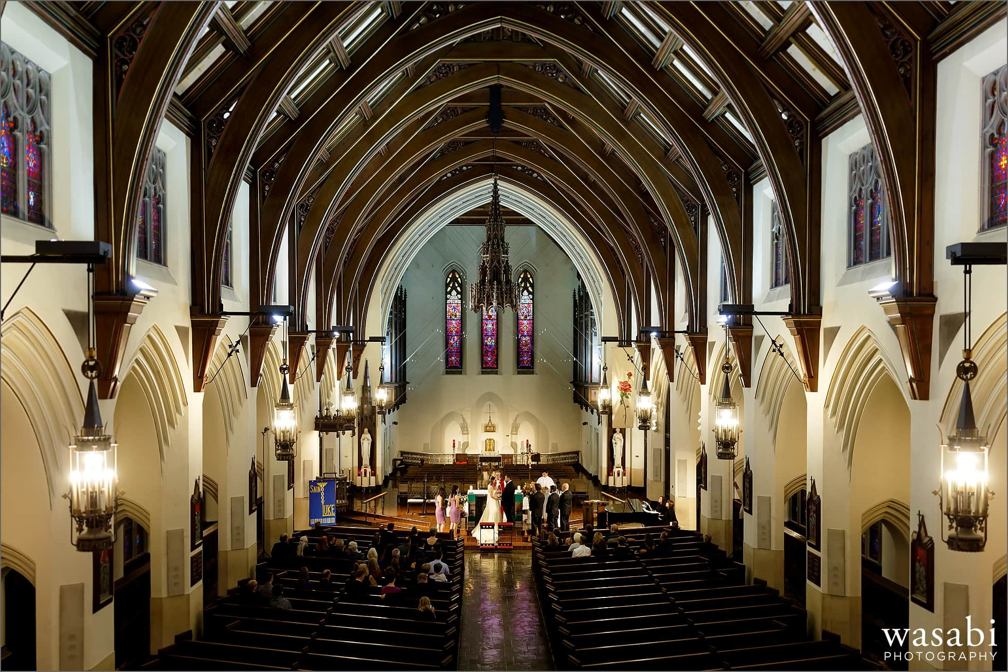 wide angle photo showing entire church during wedding ceremony at St Luke Roman Catholic Church in River Forest