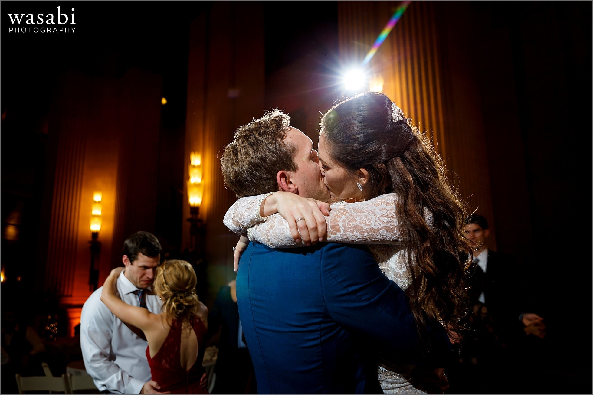 bride and groom kiss on the dance floor during Lyric Opera of Chicago wedding reception