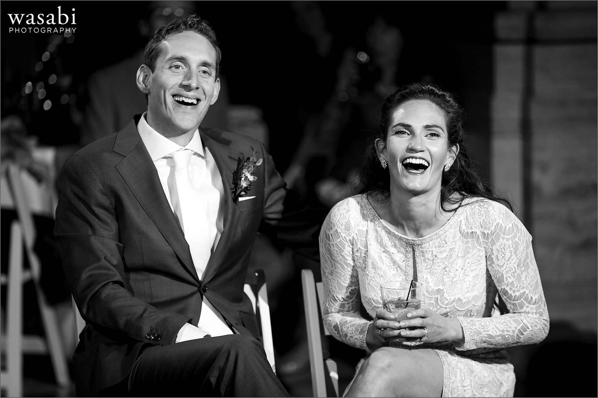 bride and groom laugh during toasts during wedding reception at Lyric Opera of Chicago wedding