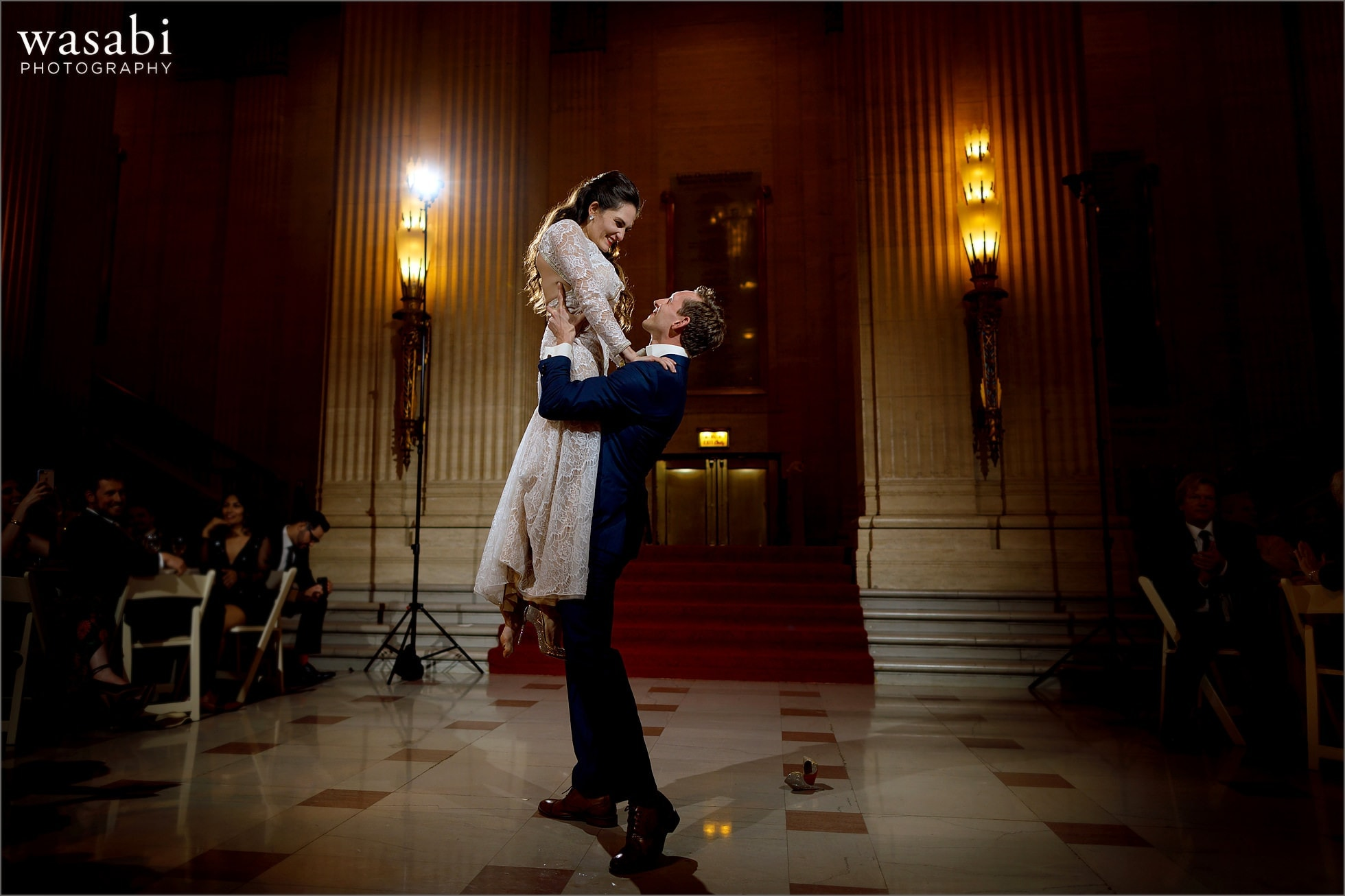 bride and groom lift during first dance at Lyric Opera of Chicago wedding reception