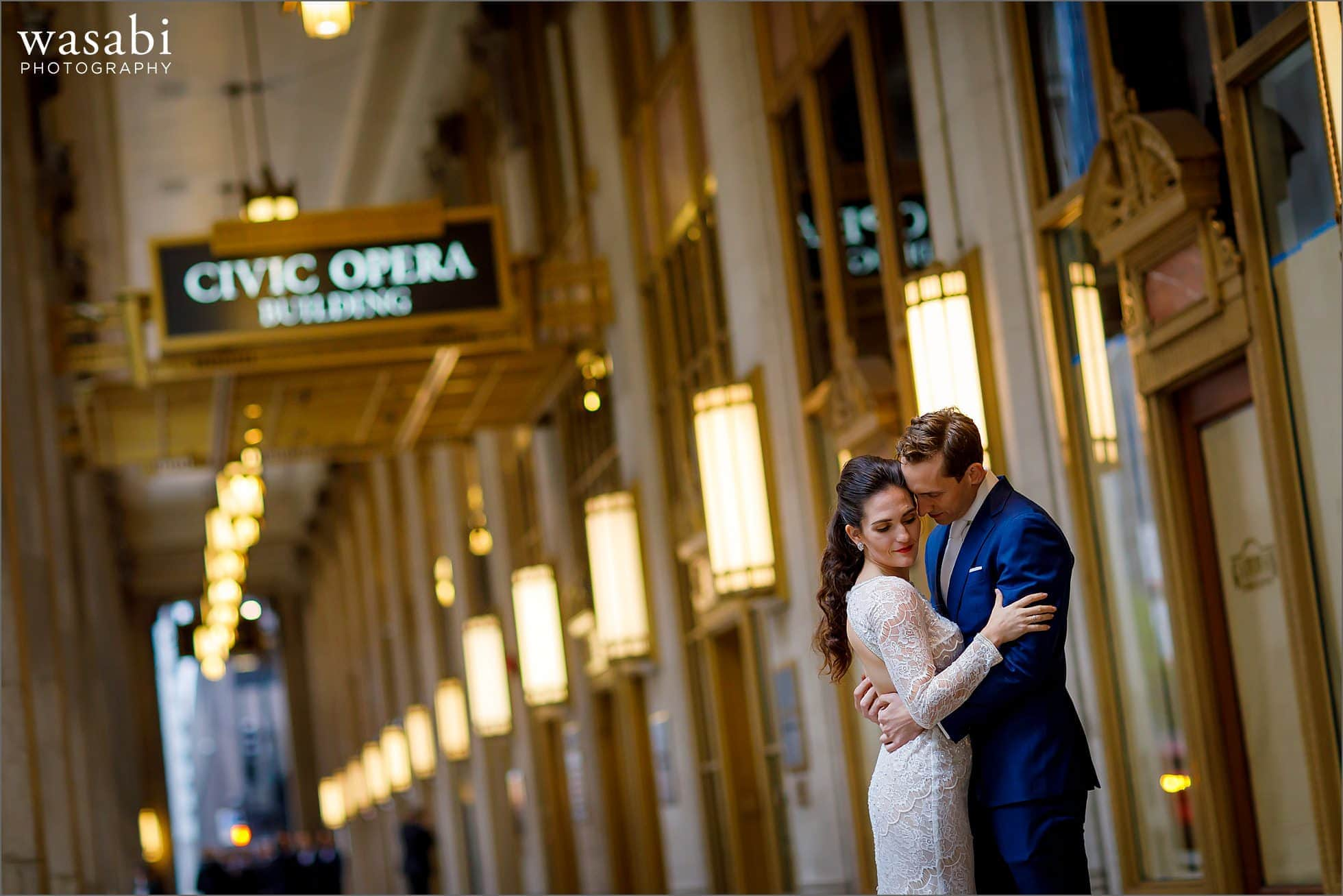 bride and groom pose for Civic Opera Building wedding portraits in Chicago