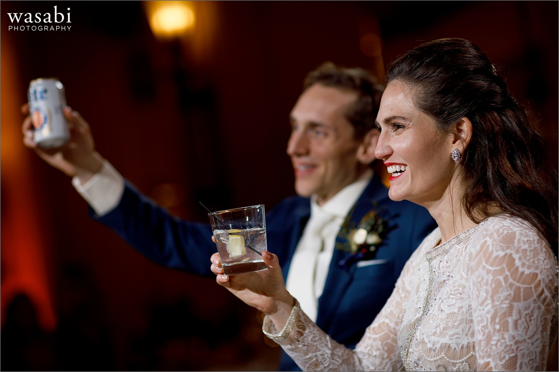bride and groom raise their glasses during toasts at wedding reception at Lyric Opera of Chicago wedding
