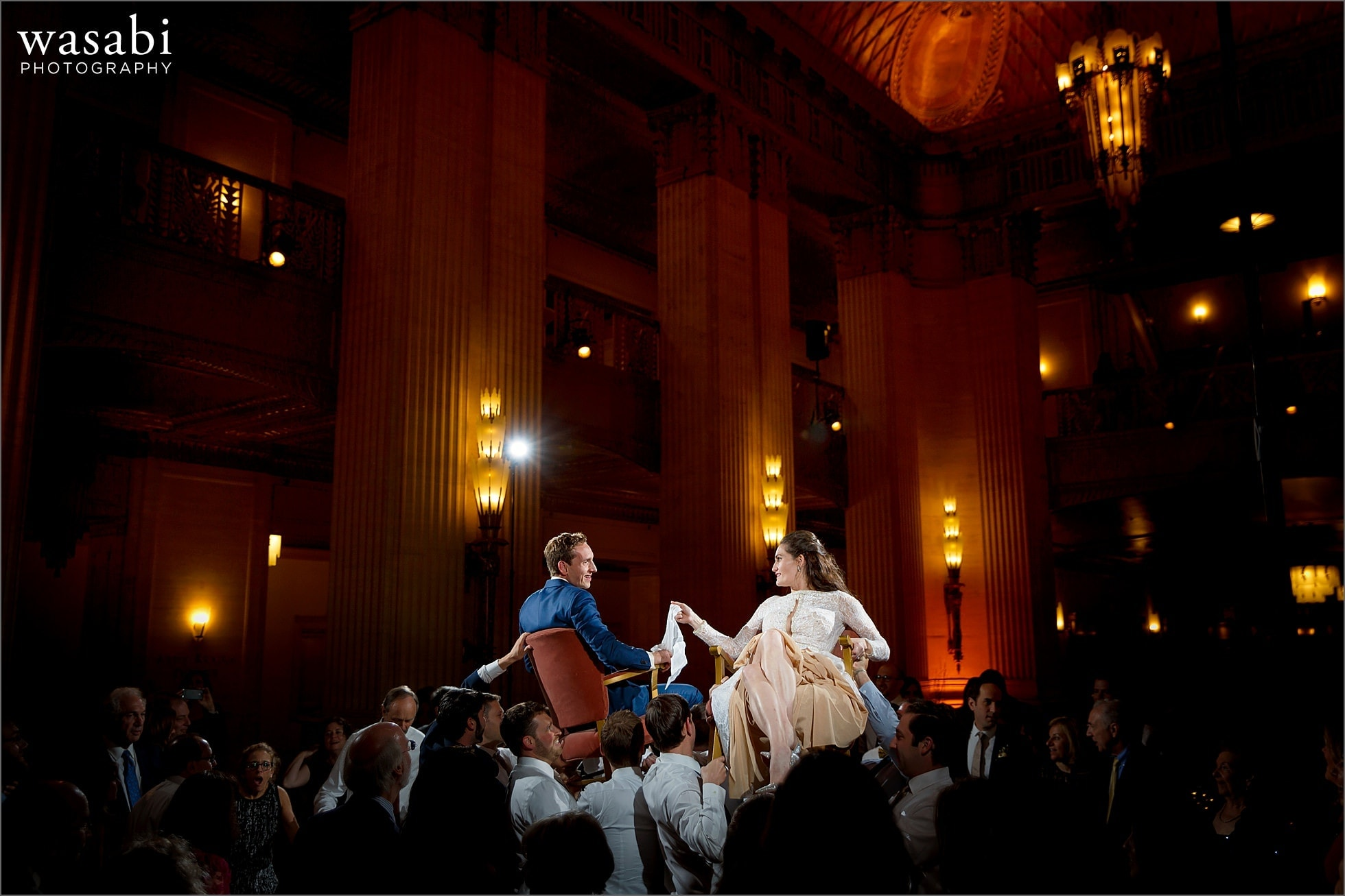 couple lifted up on chairs during the horah dance at Lyric Opera of Chicago wedding in Chicago