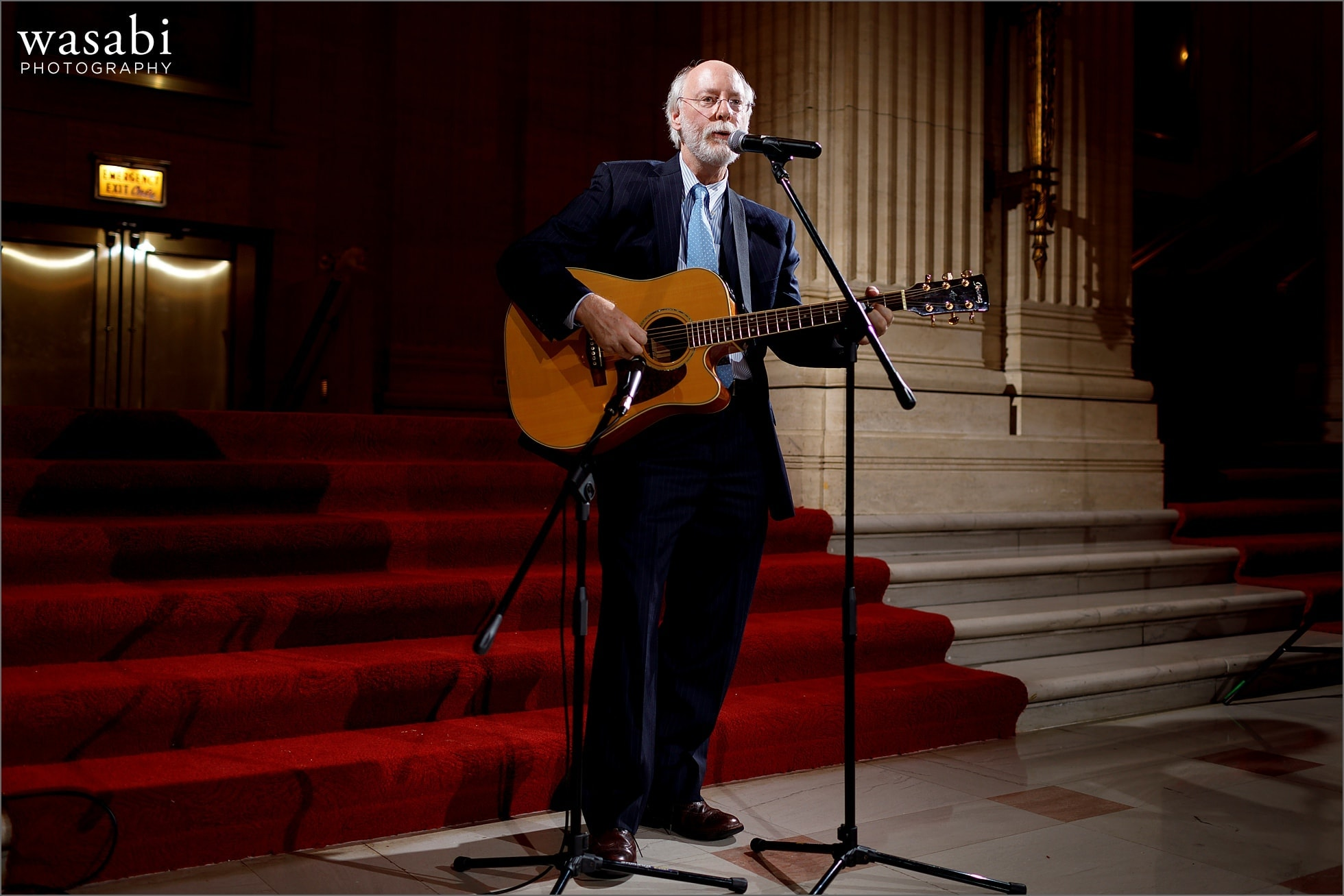 father of the groom plays a song during wedding reception at Lyric Opera of Chicago wedding