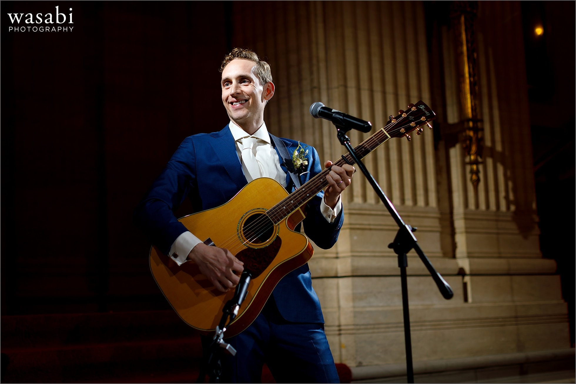 groom plays a song on the guitar during wedding reception at Lyric Opera of Chicago wedding
