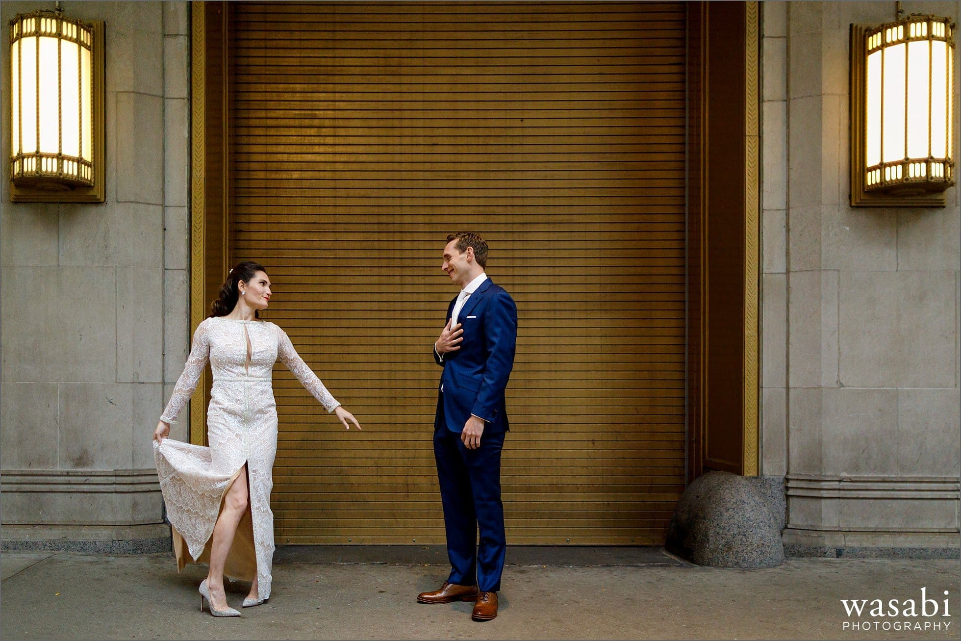groom reacts after seeing bride during first look outside Civic Opera House in Chicago before their wedding