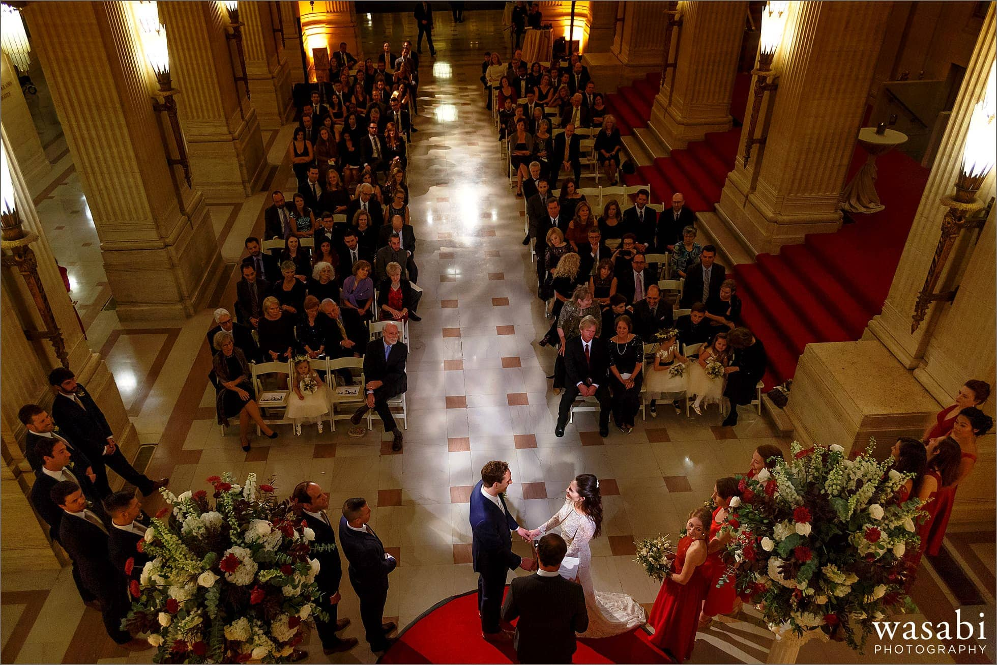 wide angle photo from balcony showing entire venue during wedding ceremony in the at Lyric Opera House Chicago wedding in Daniel F. and Ada L. Rice Grand Foyer