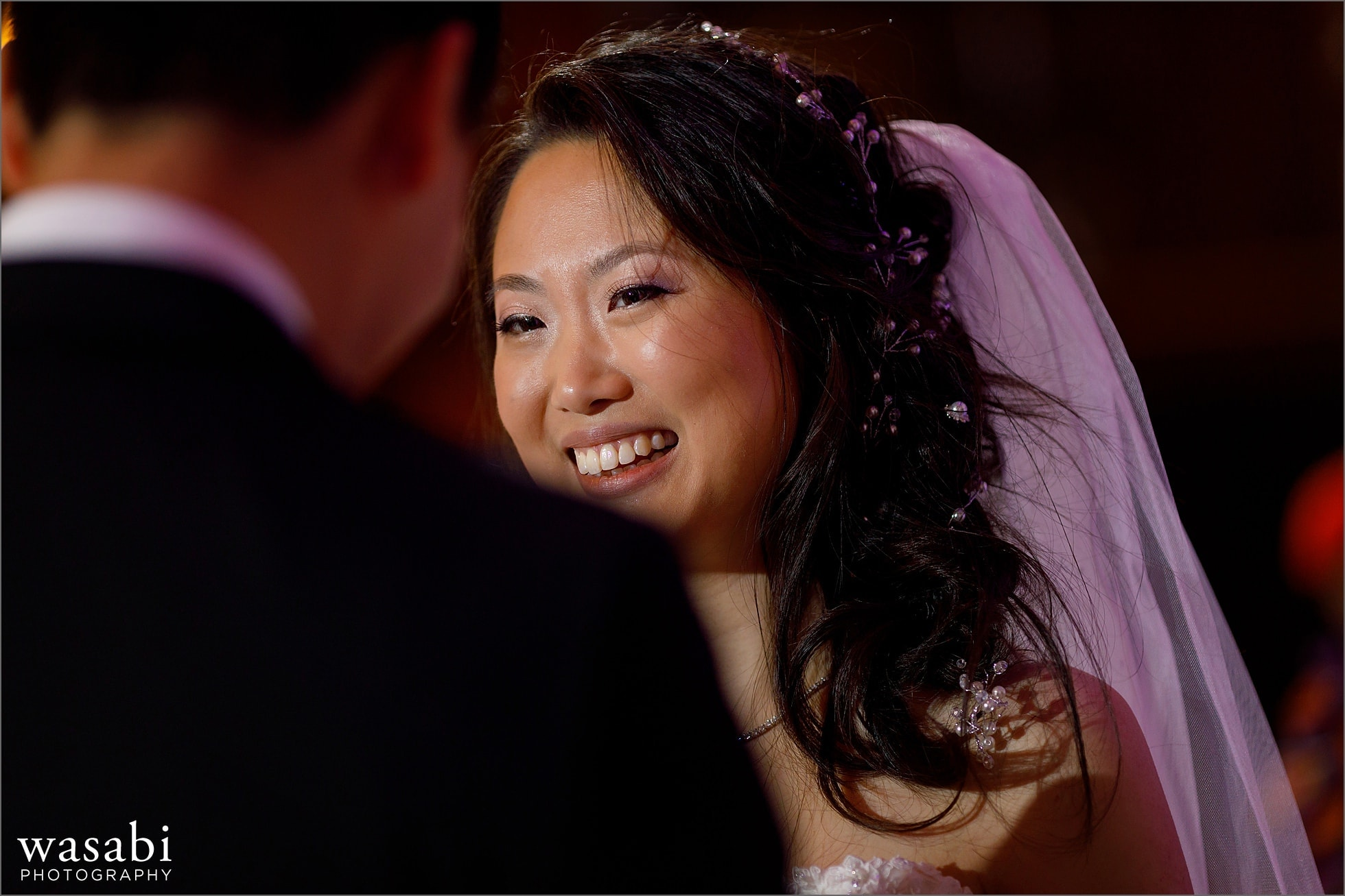 Closeup of bride smiling during wedding ceremony