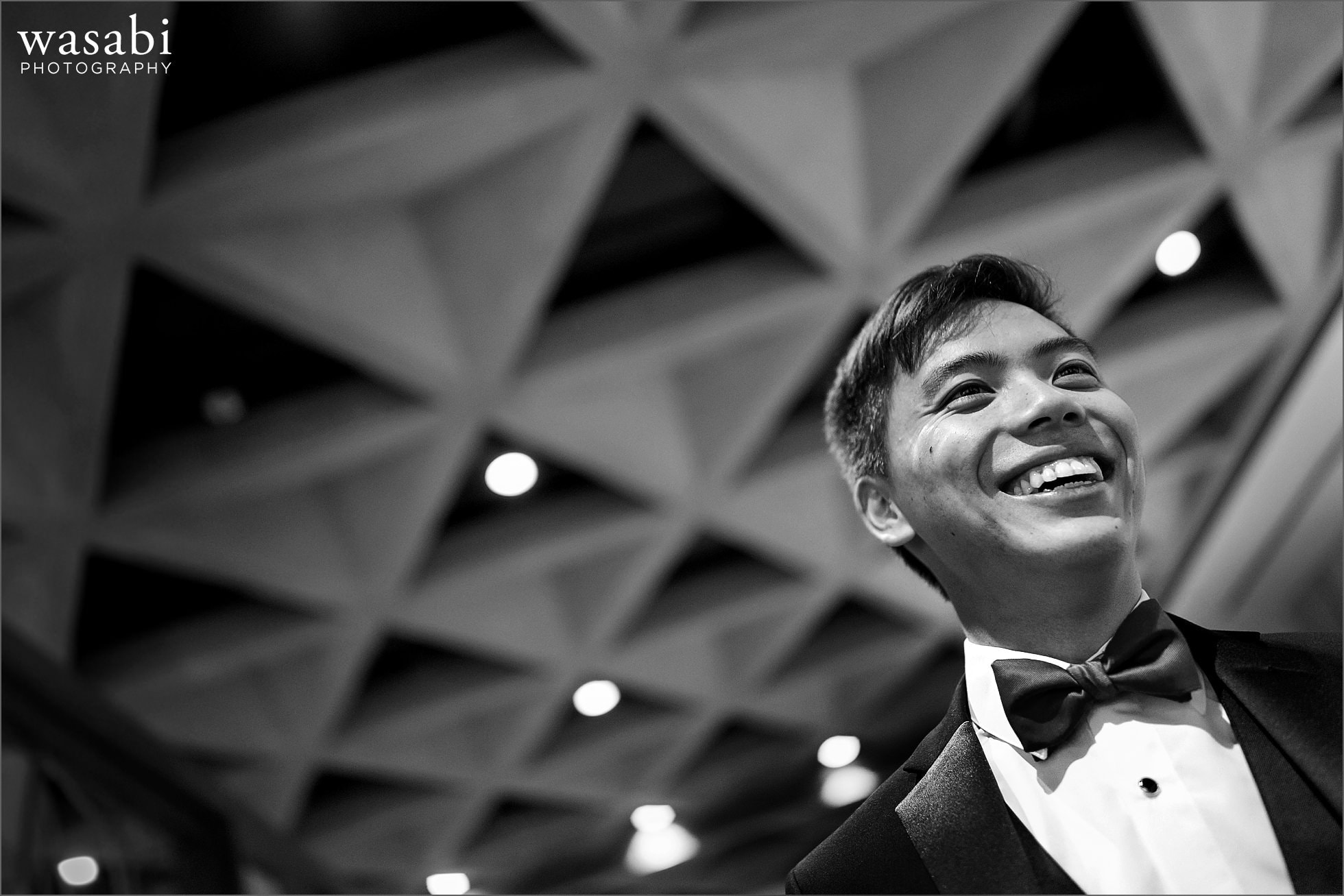 Groom smiles while waiting for his wedding