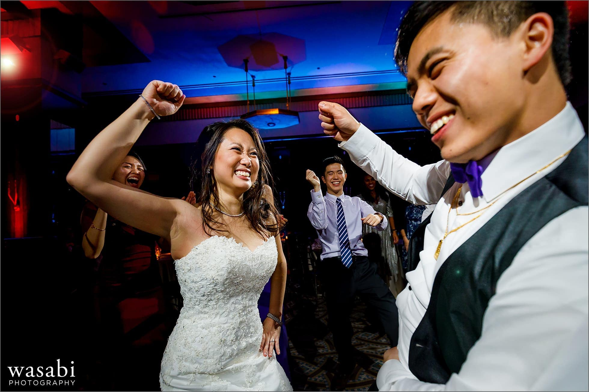 bride and groom on the dance floor with awesome color up lighting during Montgomery Club wedding reception in Chicago