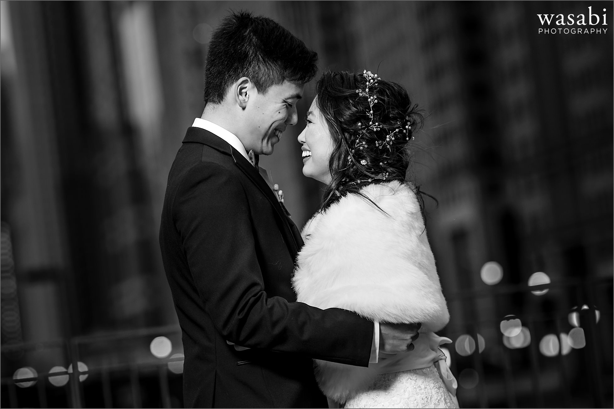 bride and groom pose for portraits in downtown Chicago