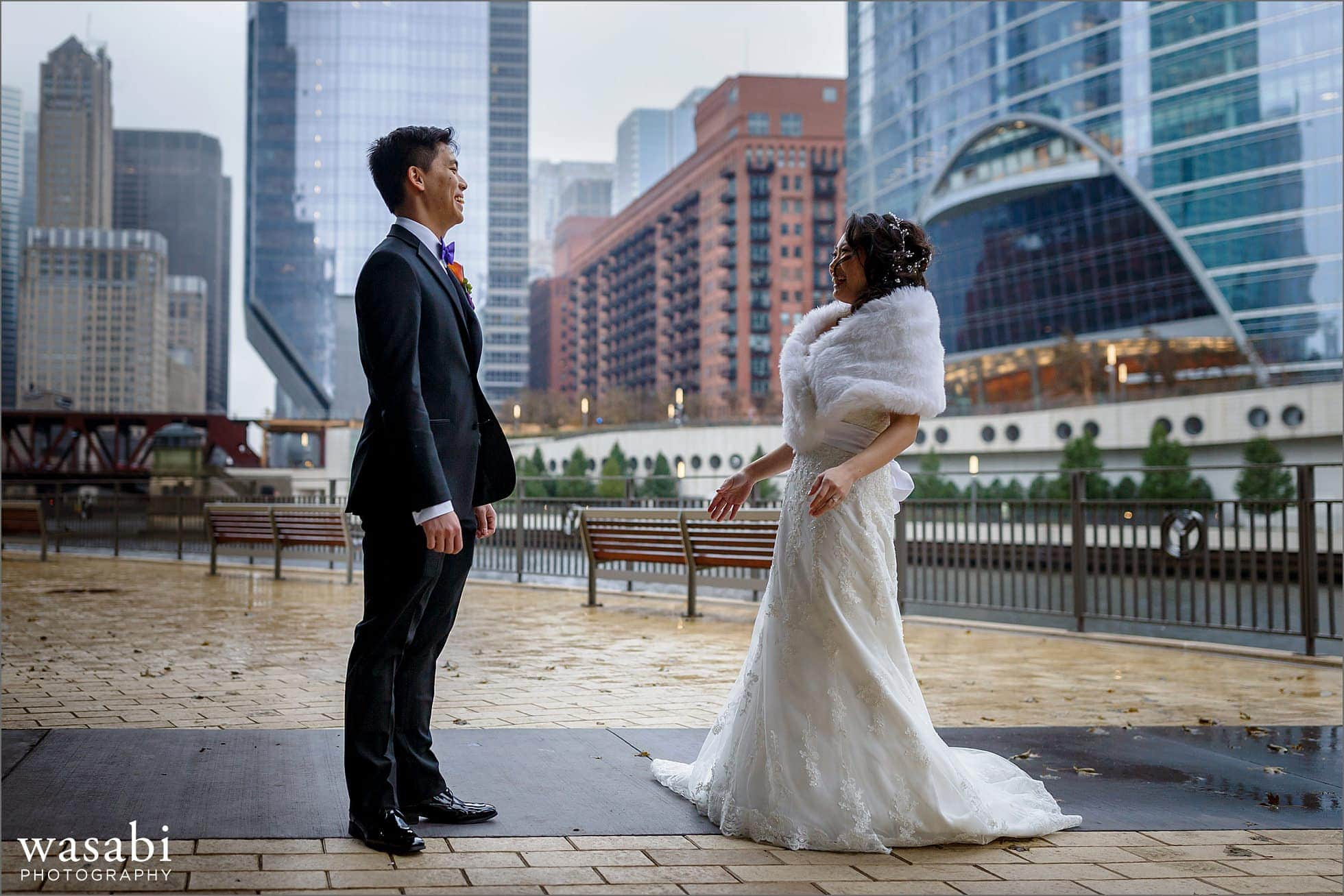 bride and groom see each other for a first look on their wedding day with the Chicago river and skyline in the background
